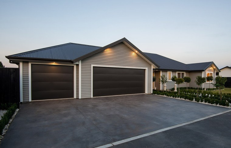 Canterbury home featuring Envira weatherboard garage asphalt, building, elevation, estate, facade, garage, garage door, home, house, luxury vehicle, property, real estate, residential area, roof, shed, siding, black, white