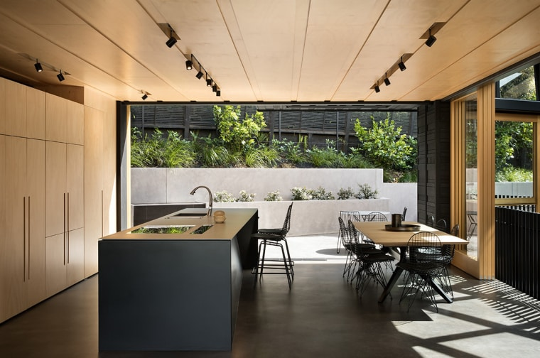 This mid-level kitchen and dining area by Strachan architecture, house, interior design, table, black, Strachan Architects, plywood, stainless steel, Blum, KWC, Tap