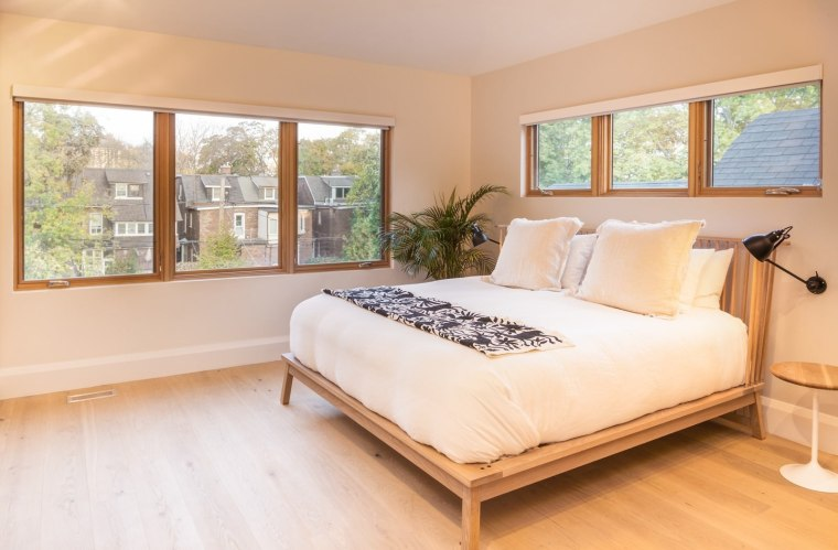 This large bedroom features ample space and light bed, bed frame, bed sheet, bedroom, ceiling, estate, floor, flooring, hardwood, home, interior design, laminate flooring, mattress, property, real estate, room, wall, window, wood, wood flooring, white, orange
