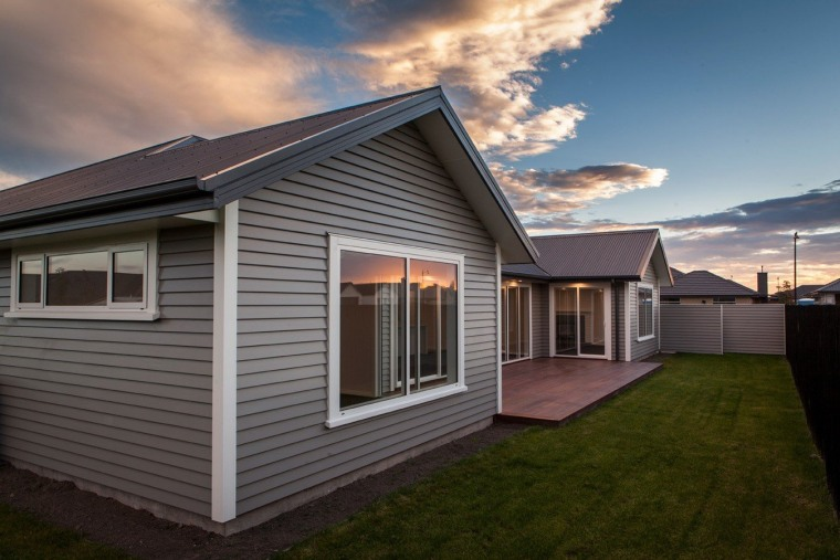 Another benefit of an Envira weatherboard fence is cottage, facade, home, house, property, real estate, residential area, roof, shed, siding, sky, window, gray