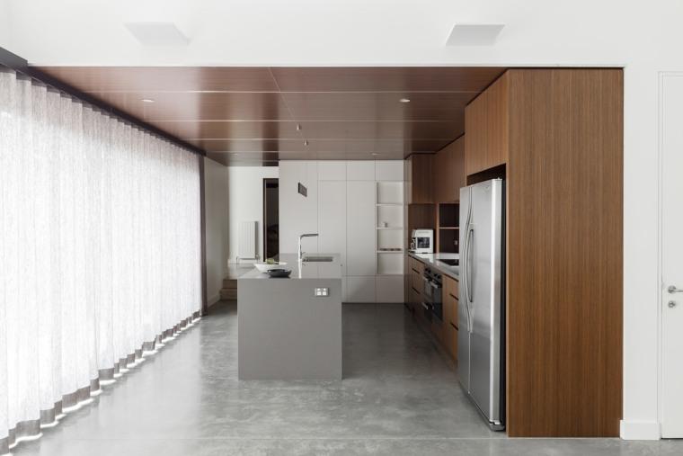 Wood features strongly in the kitchen cabinetry, floor, interior design, kitchen, product design, white