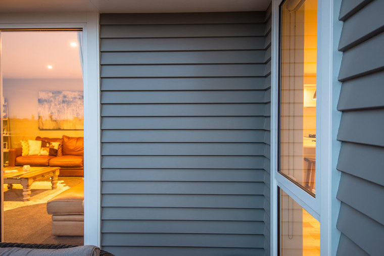 Detail of Niagara bevel back weatherboards and scribers door, facade, home, house, interior design, real estate, shade, siding, window, window blind, window covering, window treatment, wood, yellow, gray