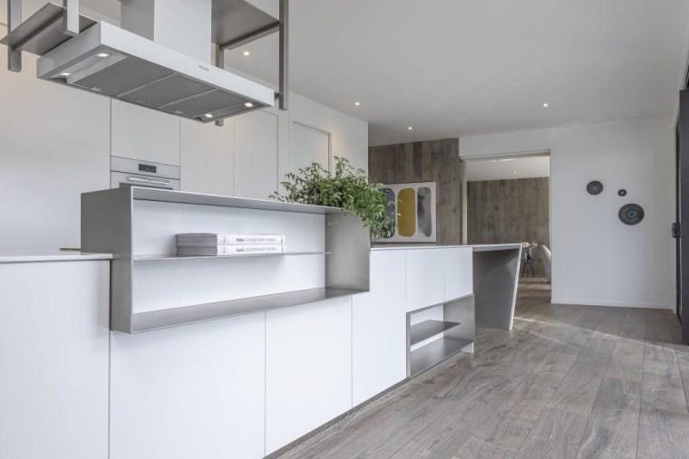 A closer look at the geometric kitchen island architecture, countertop, floor, interior design, kitchen, real estate, gray, white