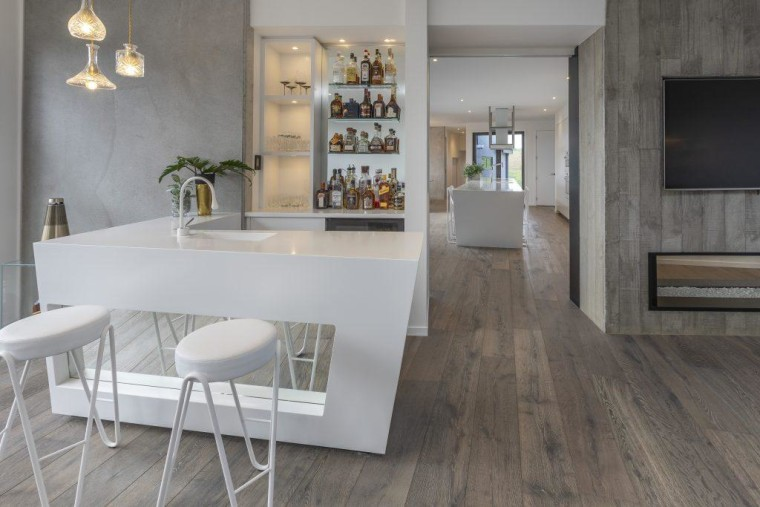 A view of the winning bar, which connects dining room, floor, flooring, furniture, hardwood, interior design, laminate flooring, table, tile, wall, wood flooring, gray