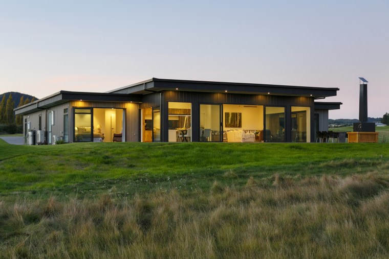 Low on the land but with great visual architecture, building, estate, facade, farmhouse, grass, home, house, land lot, landscape, property, real estate, residential area, rural area, sky, gray