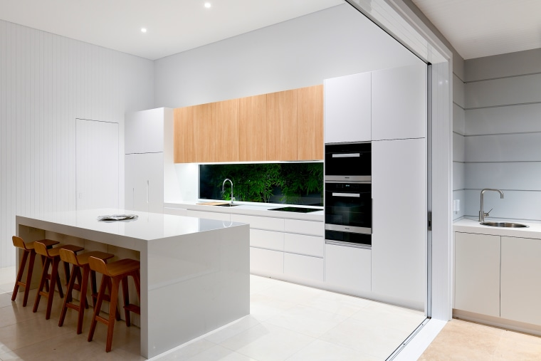 The 4m high ceilings, clear glass splashback, and architecture, building, cabinetry, ceiling, countertop, cupboard, floor, furniture, home, home appliance, house, interior design, kitchen, kitchen stove, major appliance, material property, plywood, property, real estate, room, white