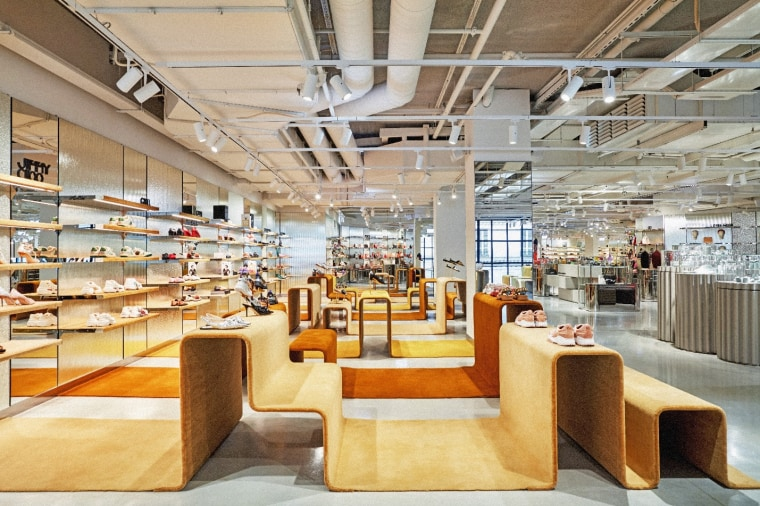 Exploring the store and its different levels is architecture, building, ceiling, design, floor, flooring, furniture, interior design, room, shelf, shelving, warehouse, gray