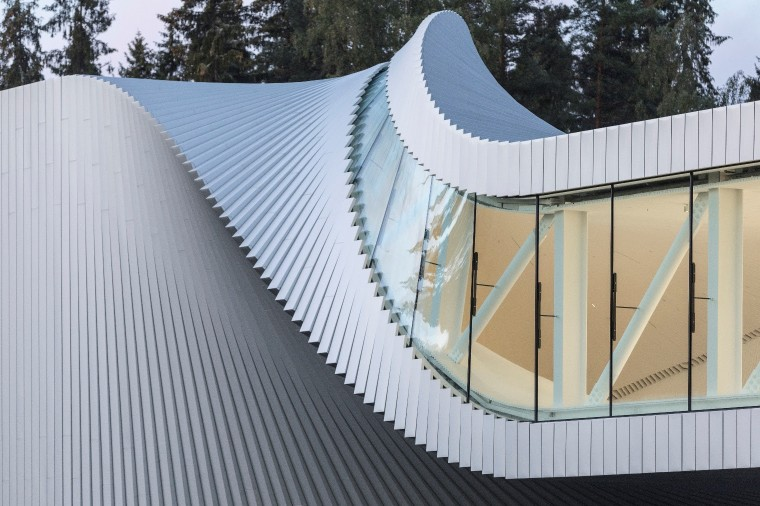 A simple twist in The Twist Museum building architecture, house, roof, wall, gray