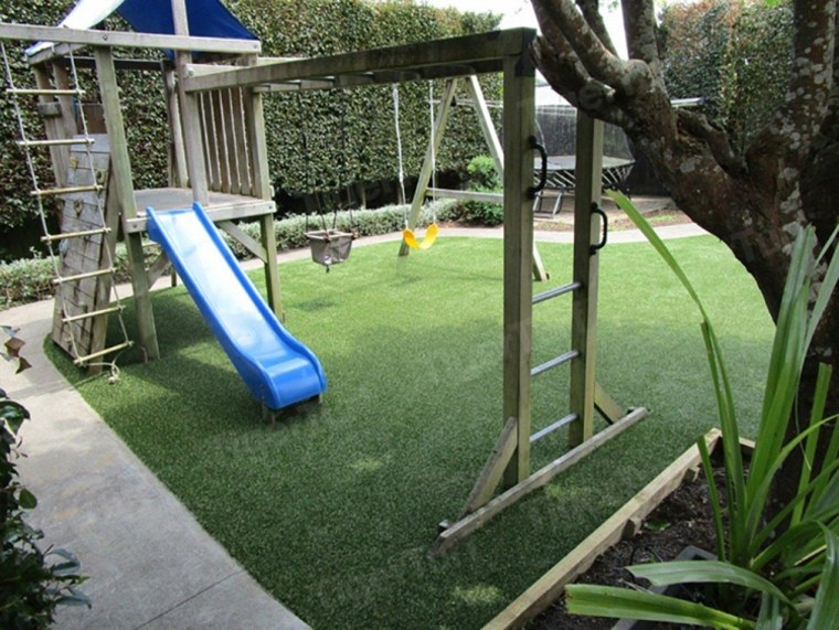 A backyard playground in Auckland that uses artificial turf, backyard, chute, grass, lawn, leisure, outdoor play equipment, plant, playground, public space, recreation, yard, green