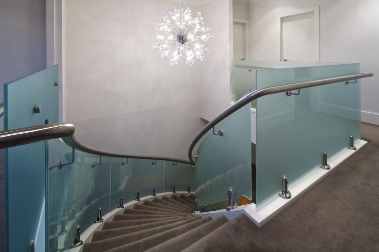 Glass safety rail around staircase. floor, glass, handrail, interior design, leisure centre, stairs, gray
