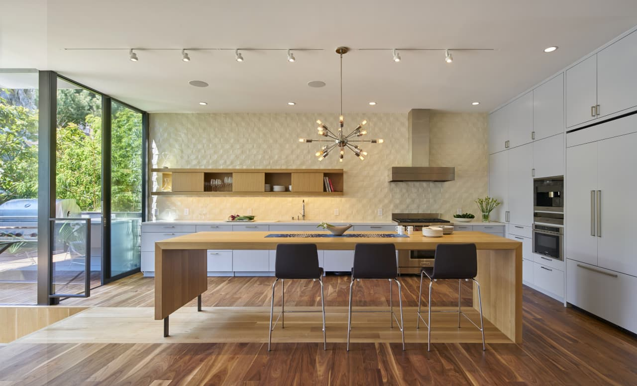 Kitchen island and formal dining table become one  Trends