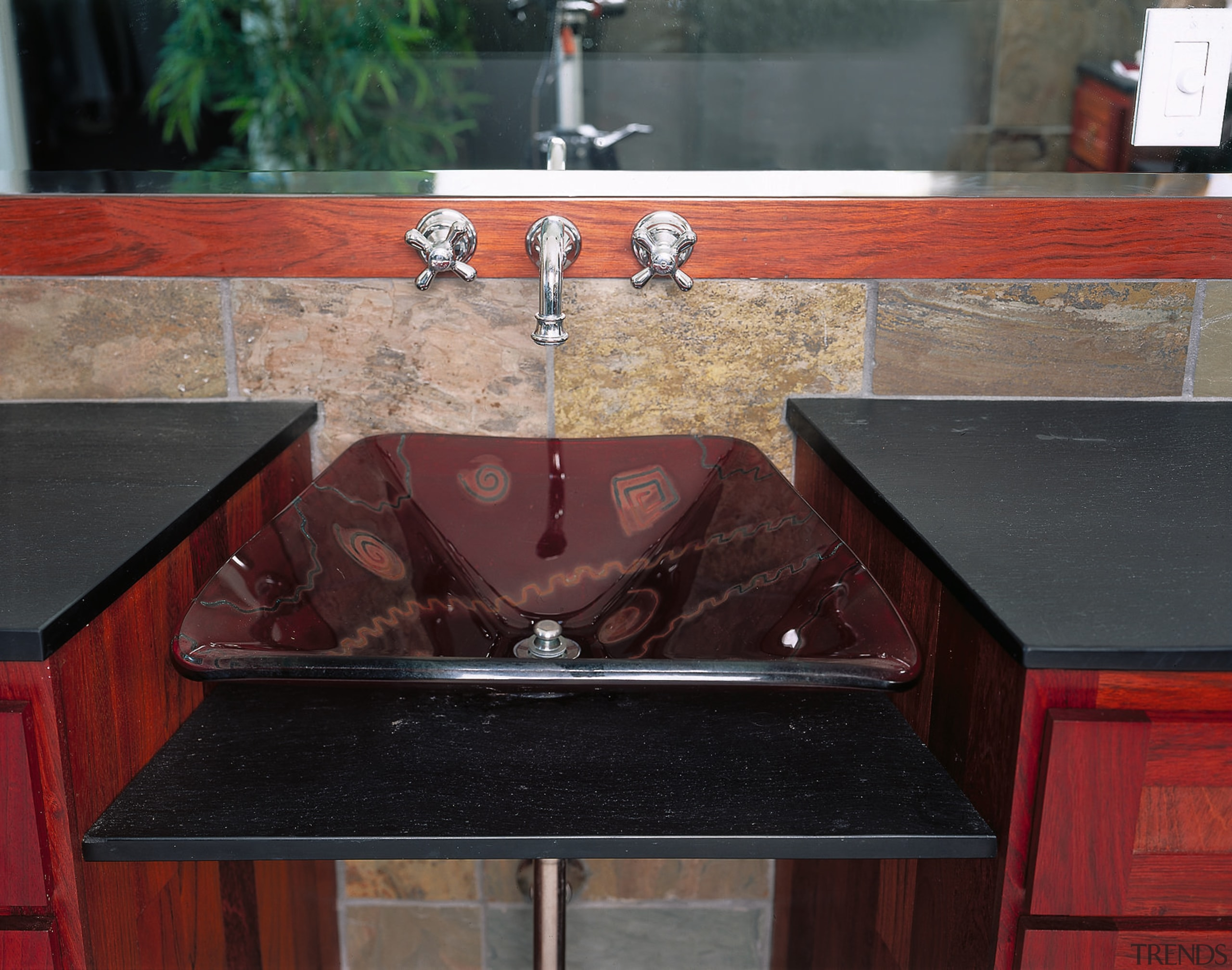 View of the hand basin - View of countertop, floor, granite, hardware, material, sink, wood stain, red, black