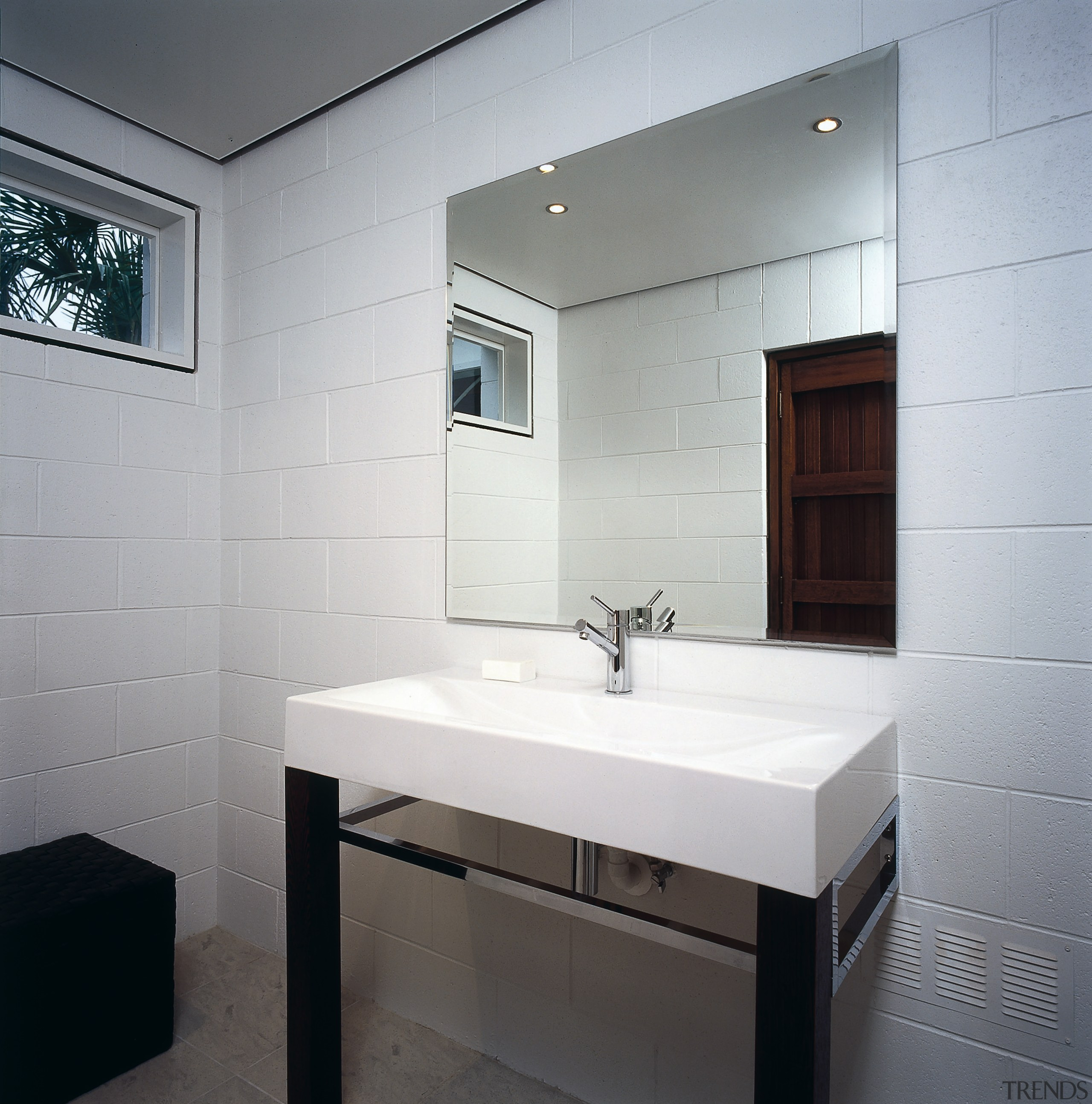 The guest bathroom of a home, showing the architecture, bathroom, bathroom accessory, floor, flooring, interior design, room, sink, tap, tile, wall, gray