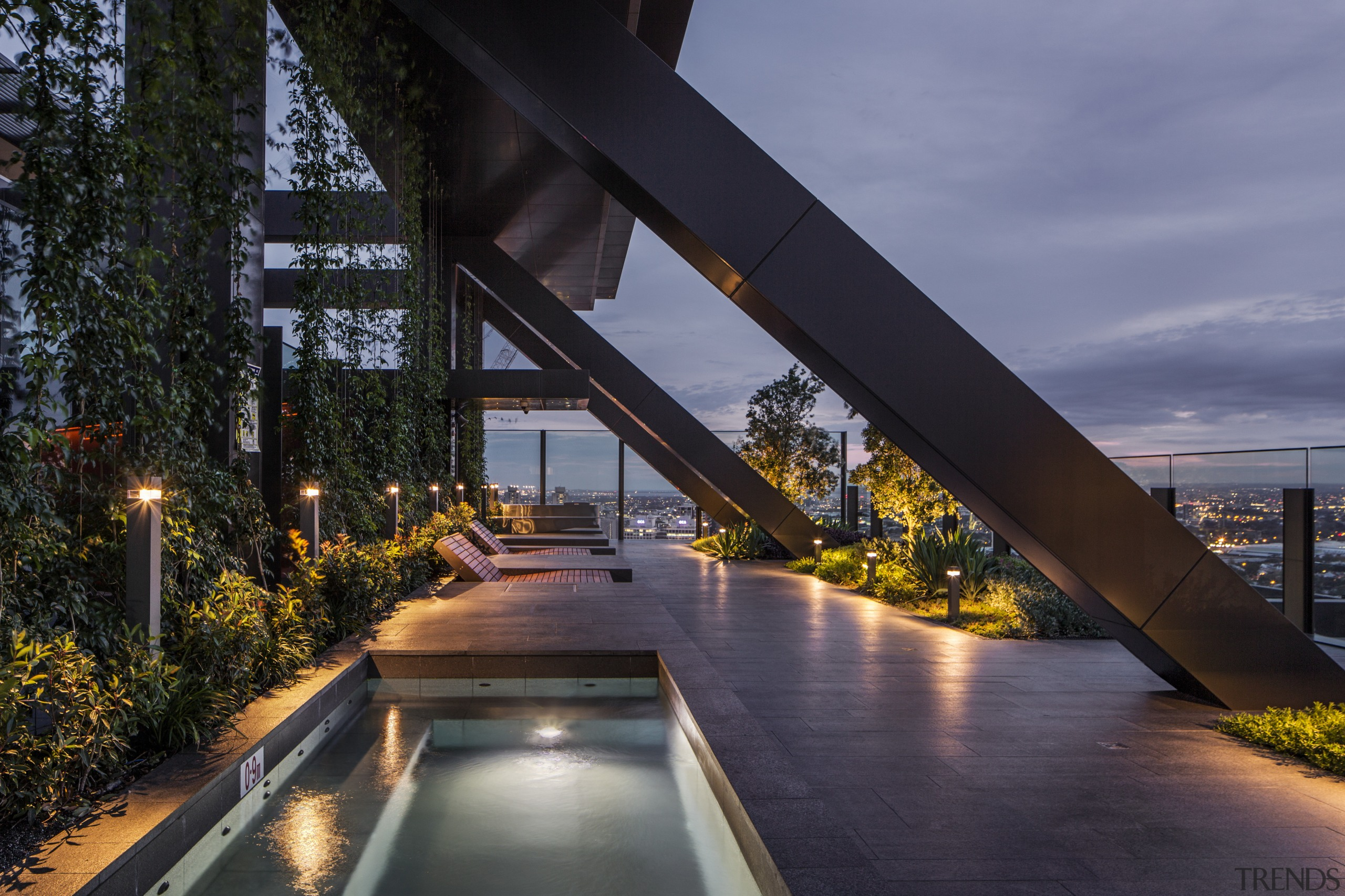 The cantilevered Sky Garden at Level 29 of architecture, bridge, condominium, evening, lighting, real estate, reflection, sky, water, black, blue