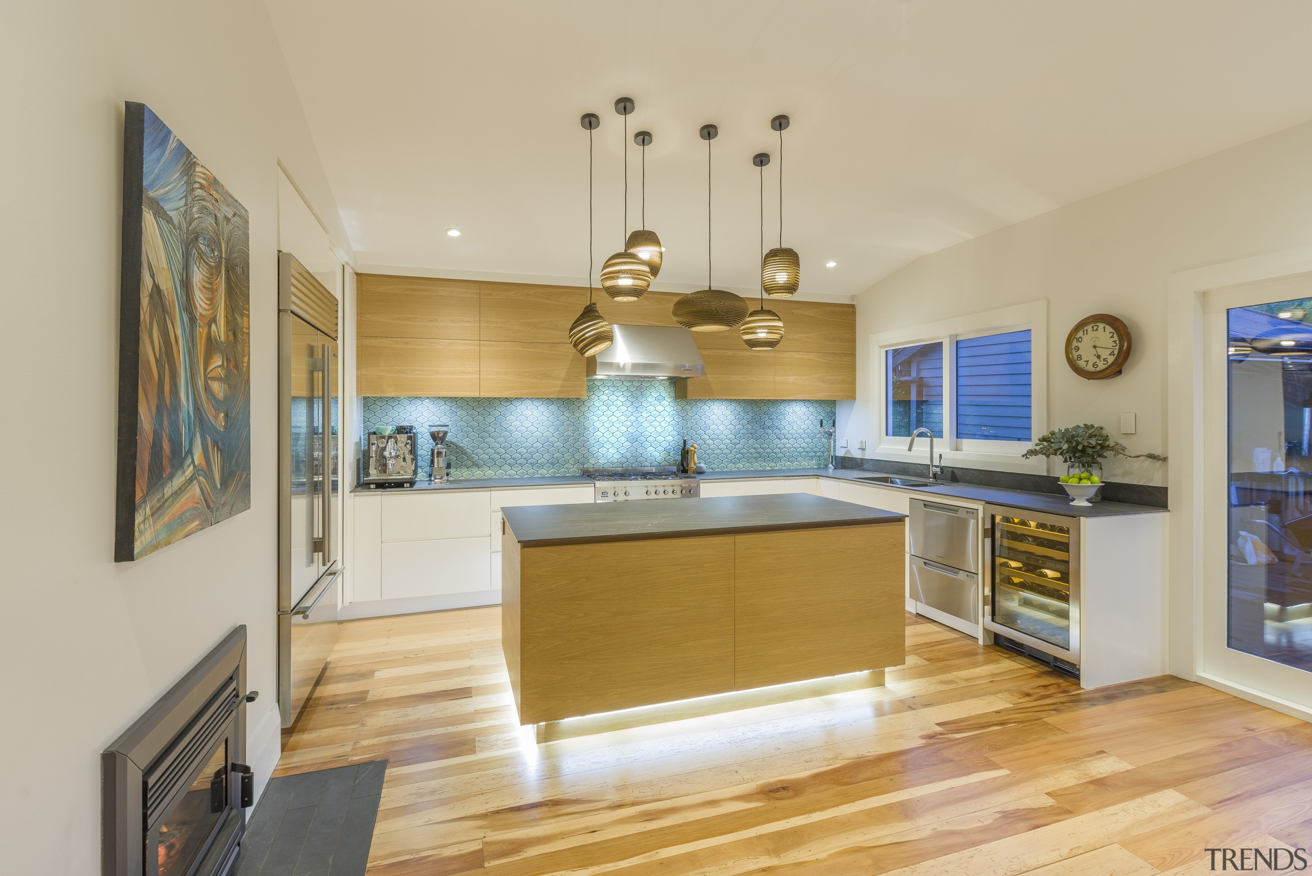 Designer Kira Gray brings a wow factor and architecture, building, cabinetry, ceiling, countertop, daylighting, estate, floor, flooring, furniture, hardwood, home, house, interior design, kitchen, laminate flooring, property, real estate, room, wood, wood flooring, yellow, orange