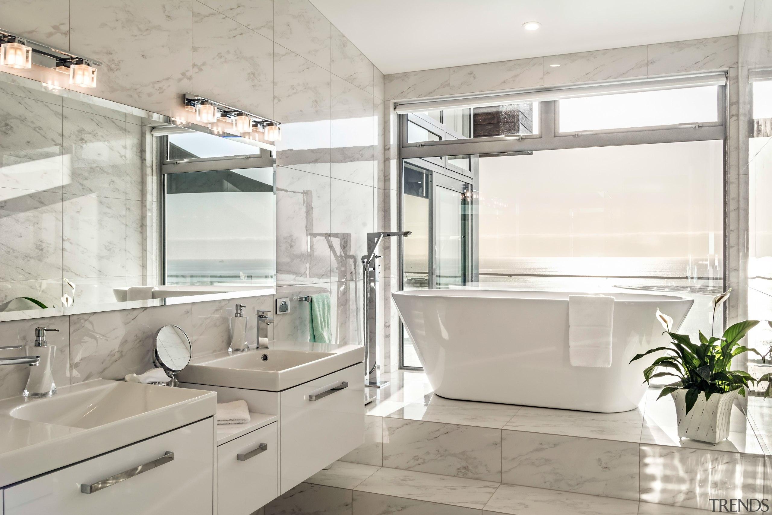 Soaking up the scenery  the bathtub arguably bathroom, interior design, sink, gray