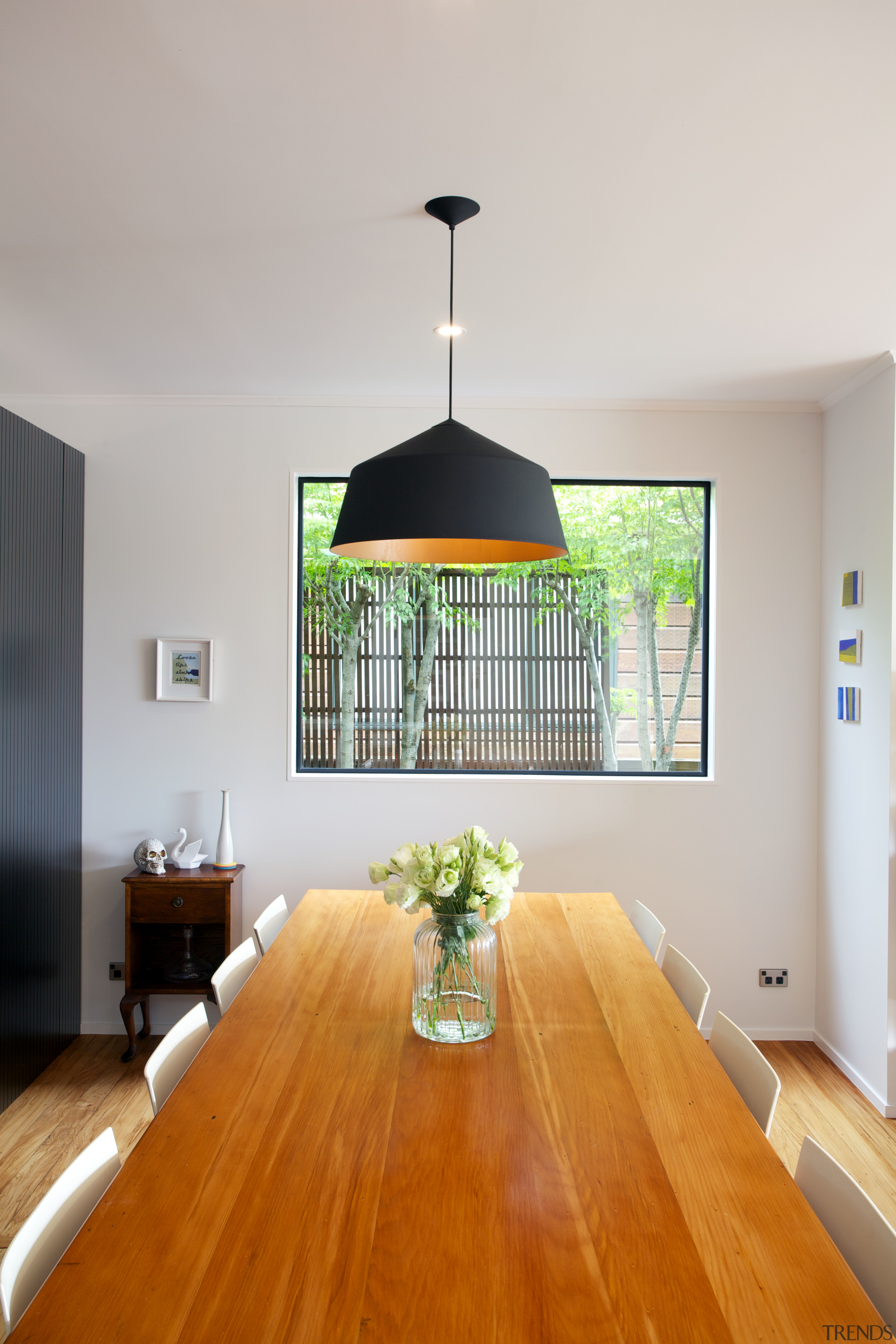 The light pendant in this remodelled family area architecture, ceiling, daylighting, dining room, floor, furniture, hardwood, home, house, interior design, light fixture, living room, real estate, room, table, gray