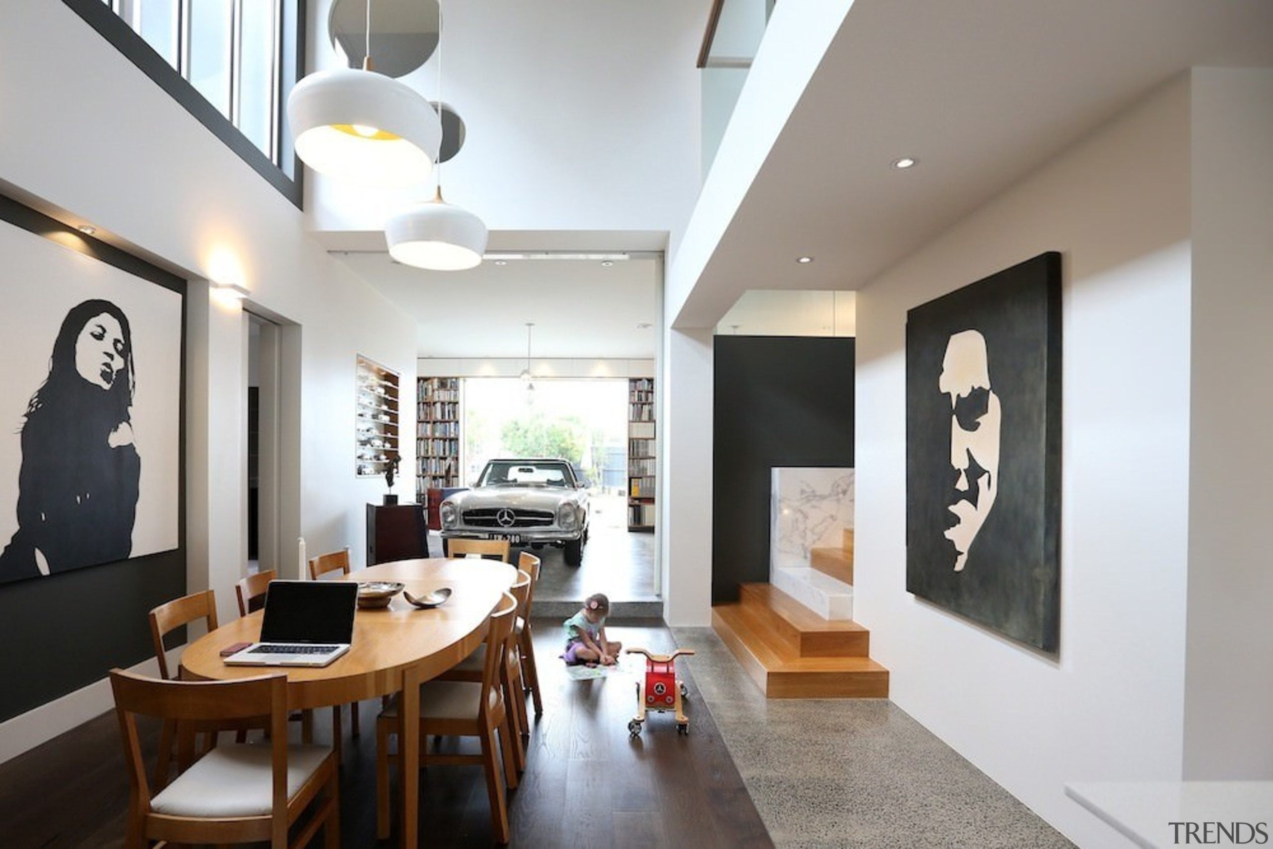 This large dining space merges into the garage/library ceiling, interior design, living room, room, gray, white
