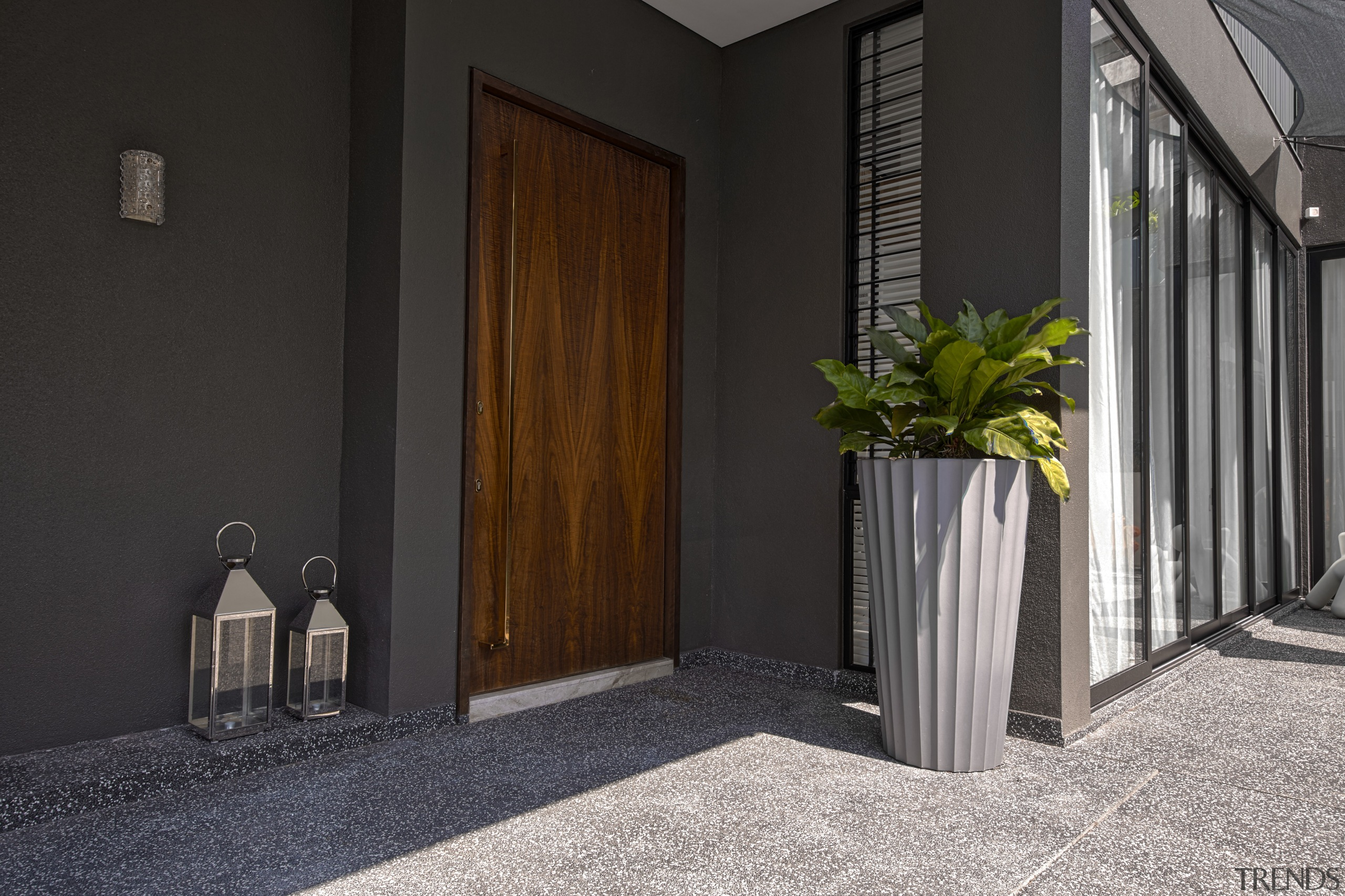 In a home that celebrates natural finishes throughout, architecture, door, home, house, interior design, property, wood, black