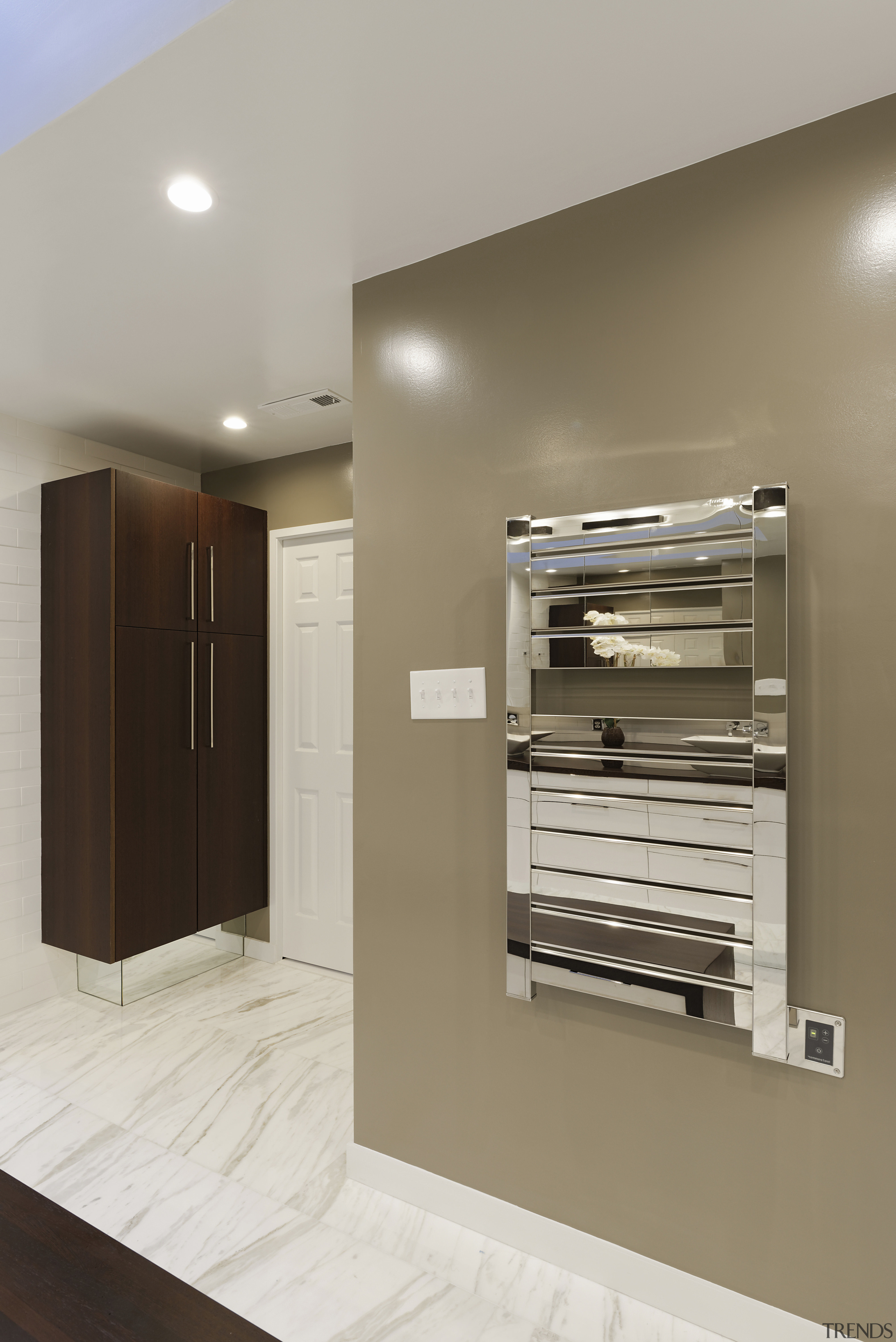 Chrome accessories set off this bathrooms high-end material floor, interior design, brown, gray