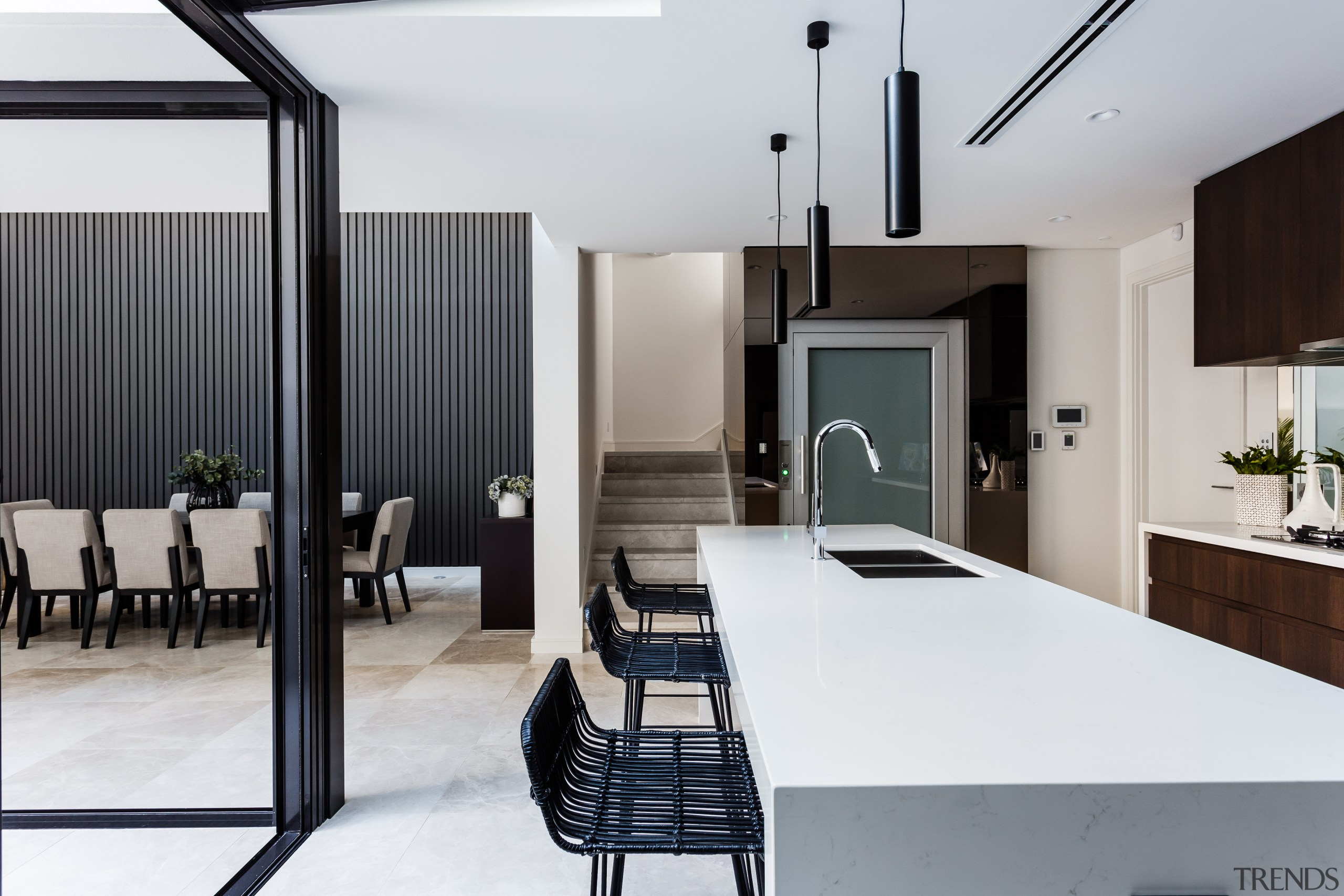 This two-tone kitchen is on view from the architecture, house, interior design, table, white, gray, black