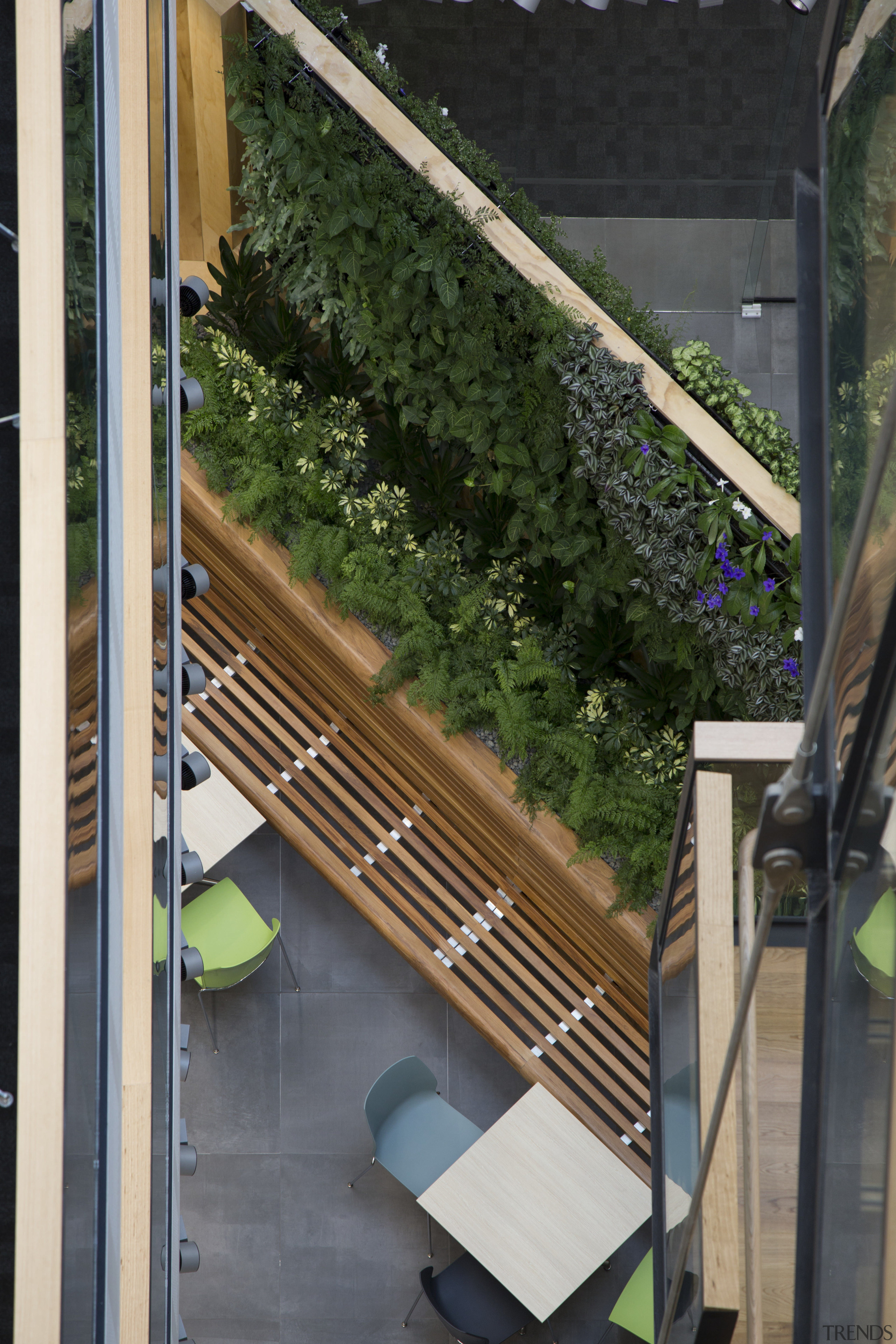 The Datacom atrium green wall as viewed from architecture, balcony, courtyard, handrail, house, outdoor structure, stairs, black