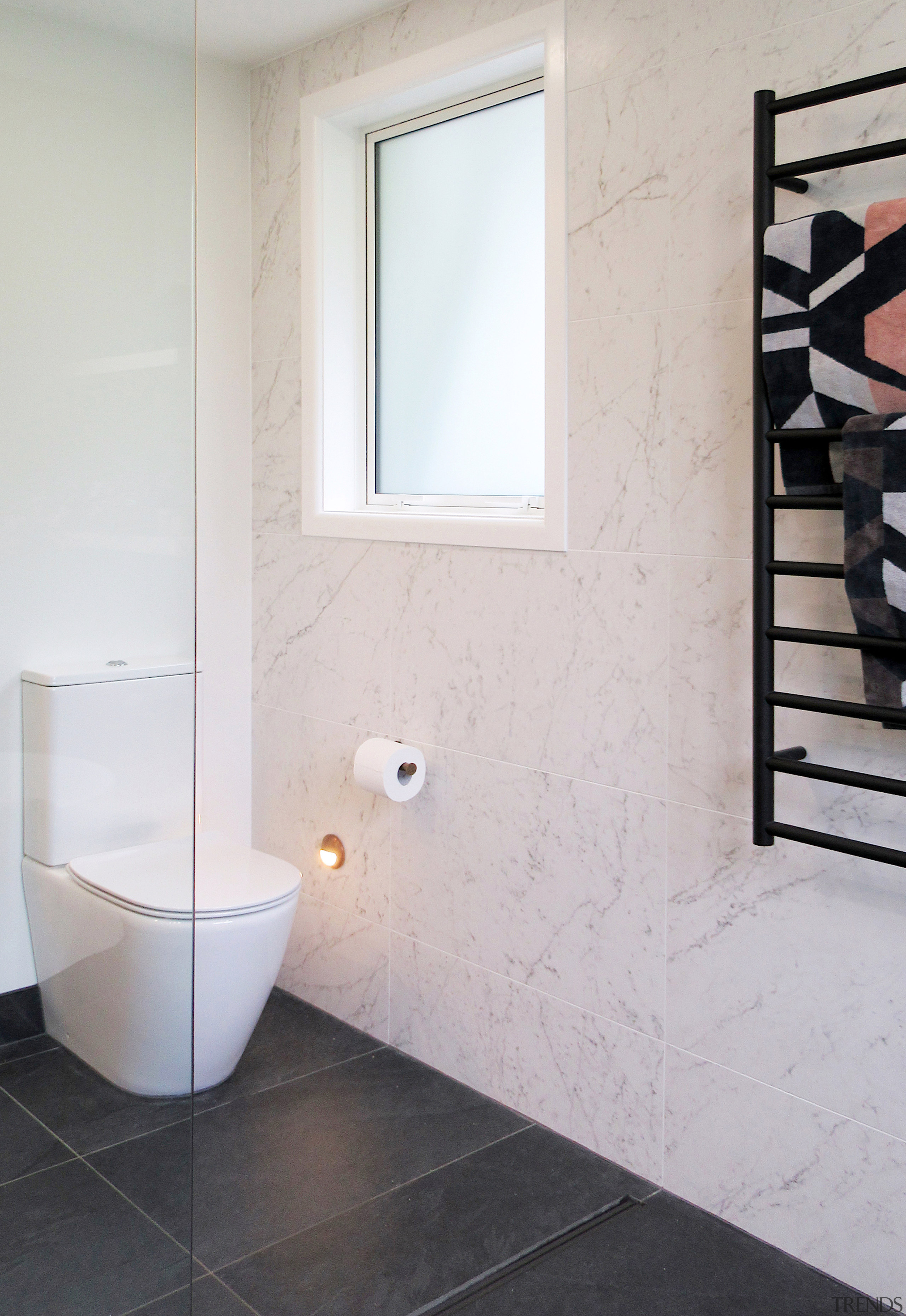 Positioned on a white painted wall, the toilet gray