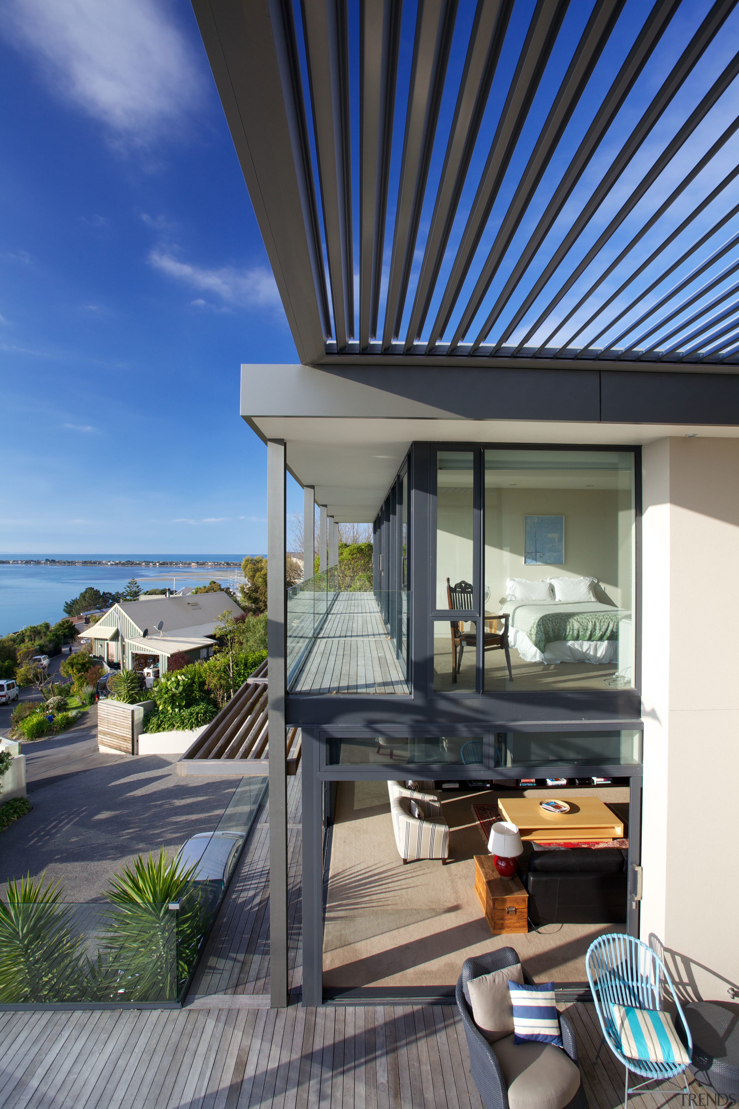Sheltered outdoor living in hillside home with long apartment, balcony, home, house, penthouse apartment, property, real estate, black, gray, blue