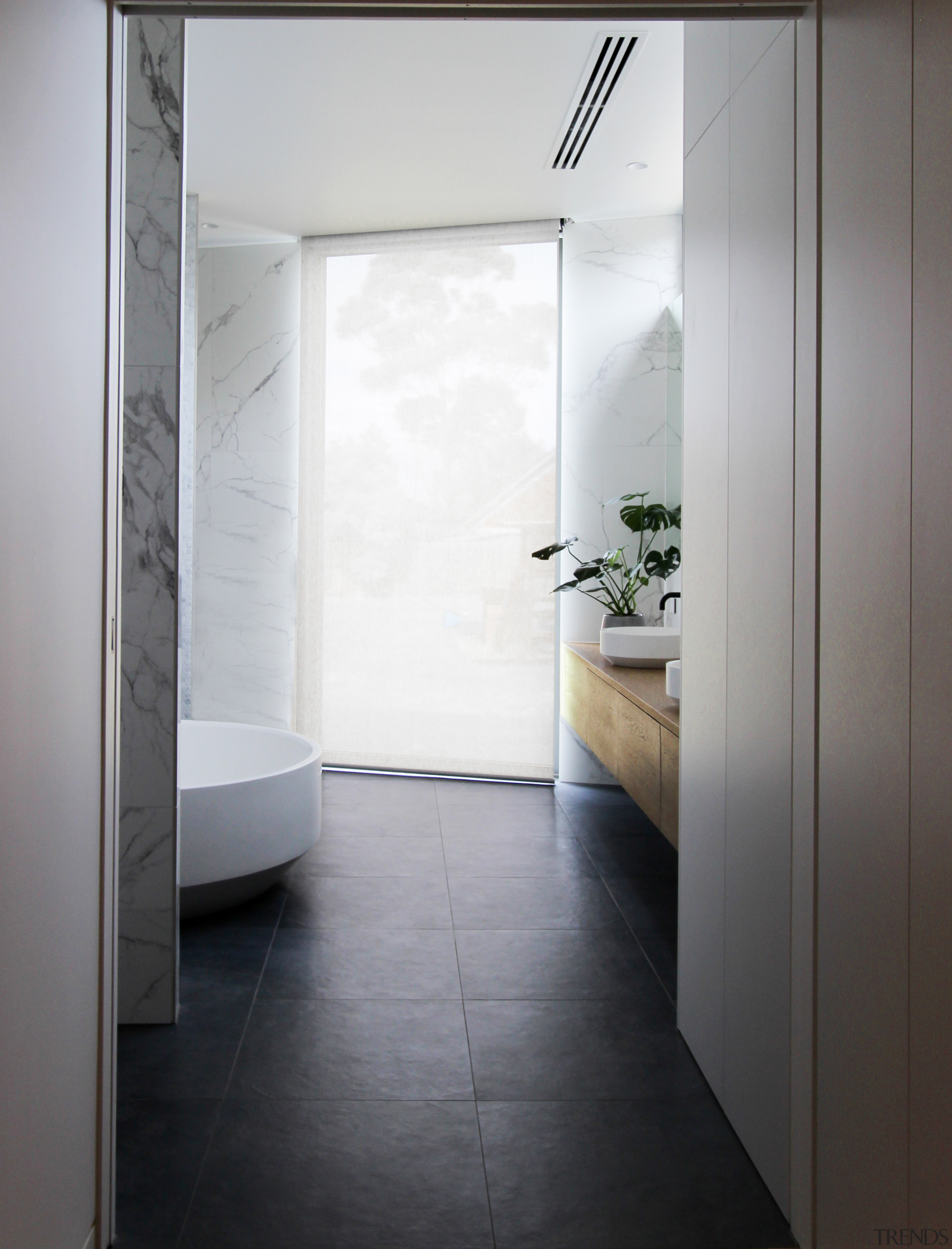 A large inoperable window in this master ensuite gray