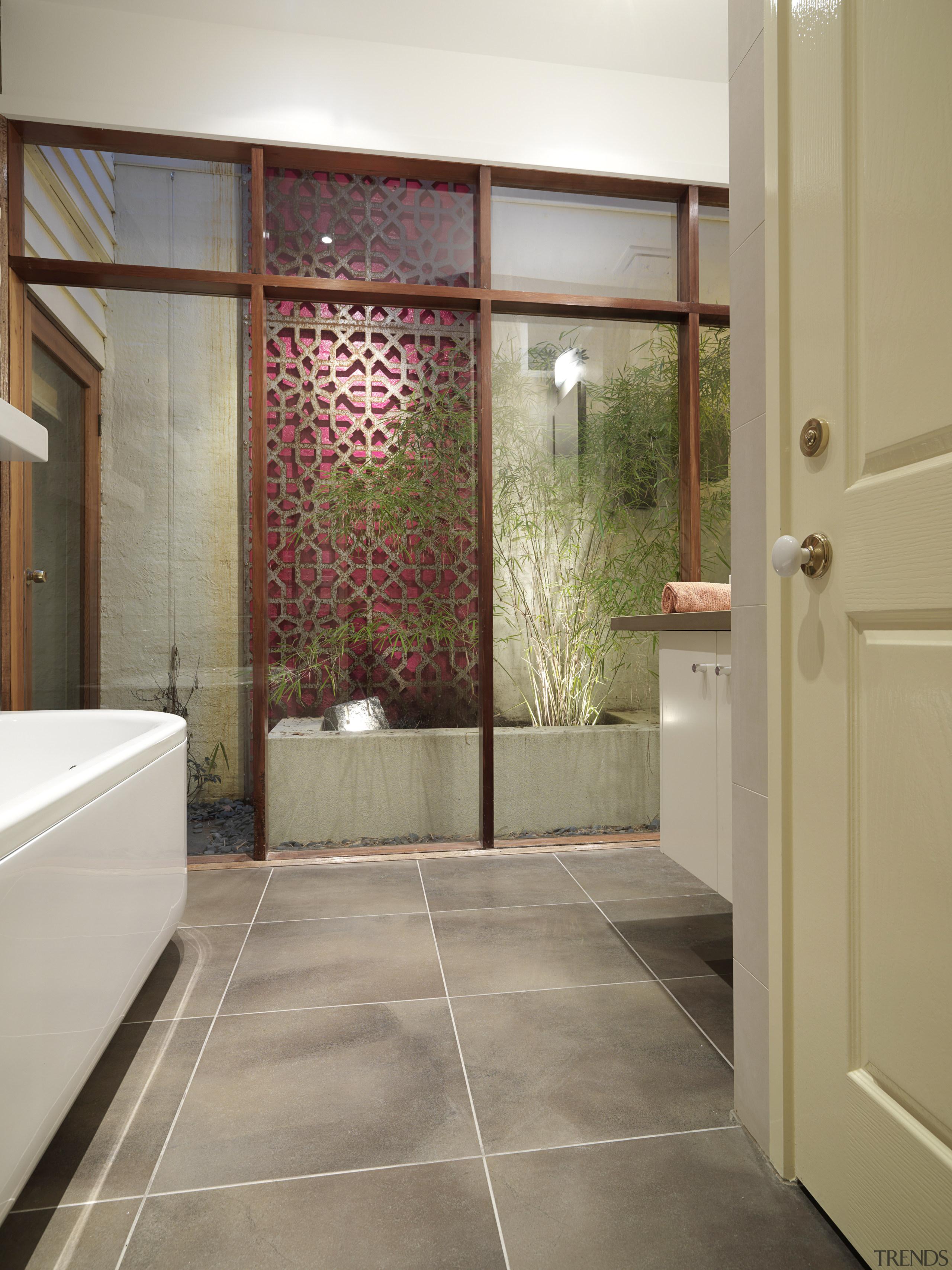 View of renovated bathroom, featuring bathtub, ceramic tiled architecture, bathroom, ceiling, door, floor, flooring, interior design, room, tile, wall, gray, brown