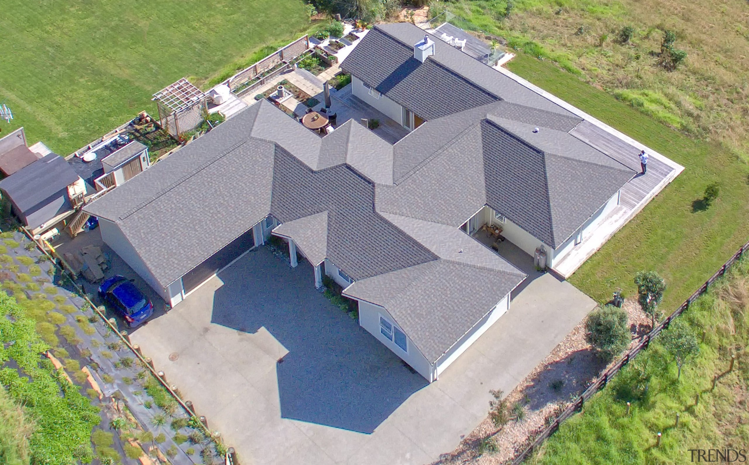 This U-shaped Fowler Homes residence wraps around three aerial photography, architecture, bird's eye view, estate, home, house, property, real estate, roof, gray, fowler homes, new home,  house, design and build