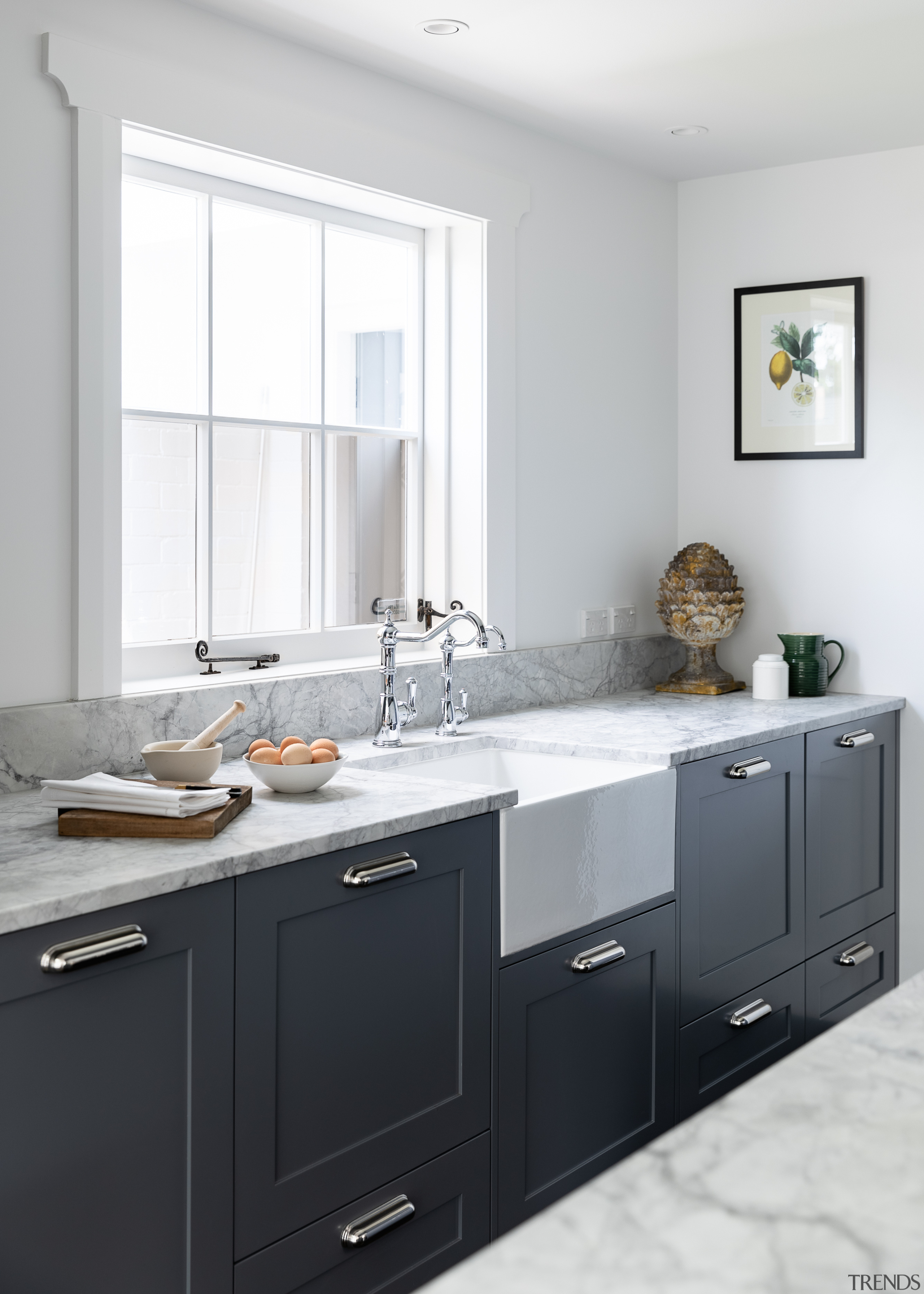 A sturdy butler's sink in the kitchen adds