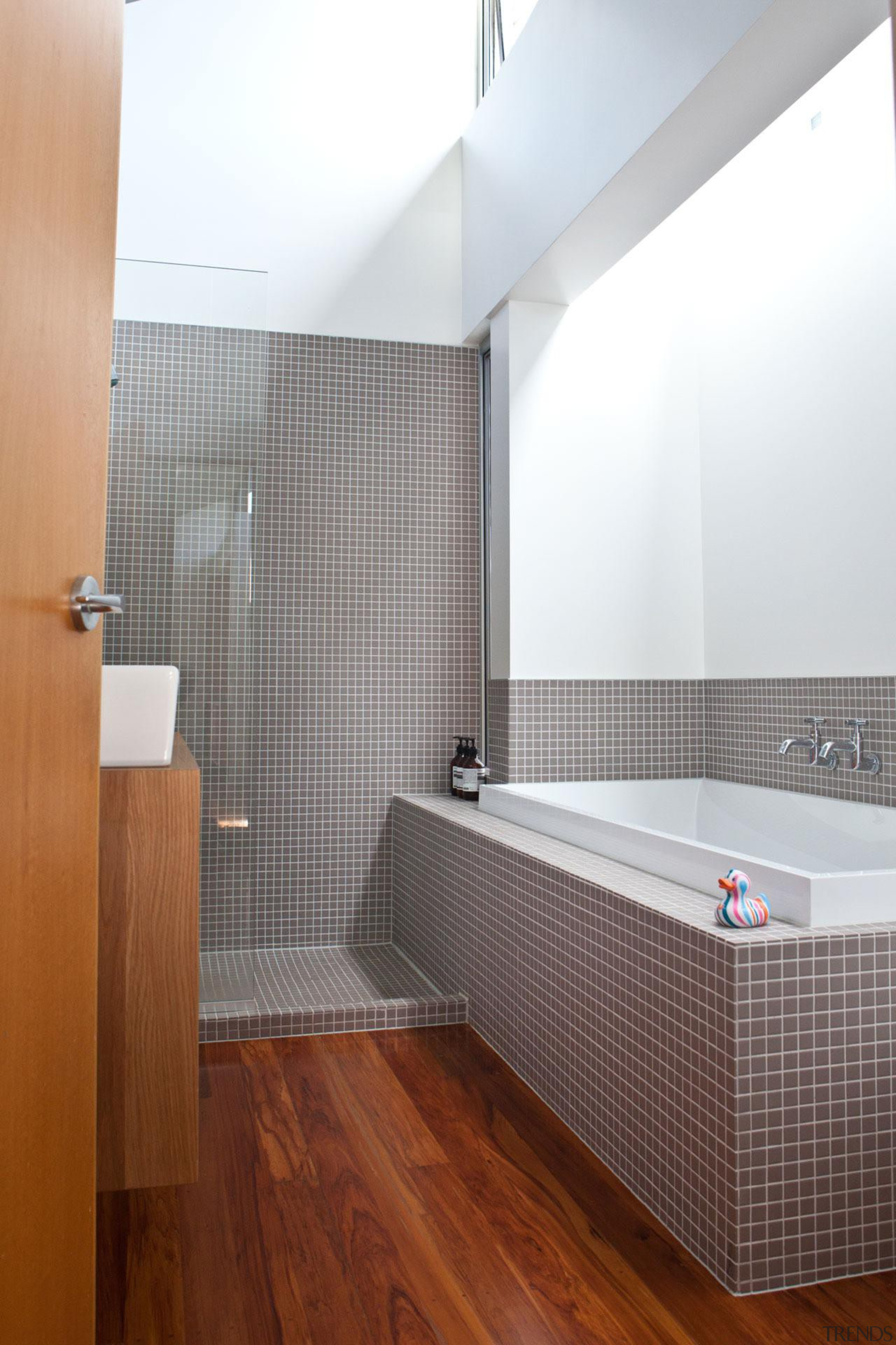 The oak vanity and timber floors provide a architecture, bathroom, daylighting, floor, flooring, interior design, laminate flooring, room, tile, wall, wood flooring, white