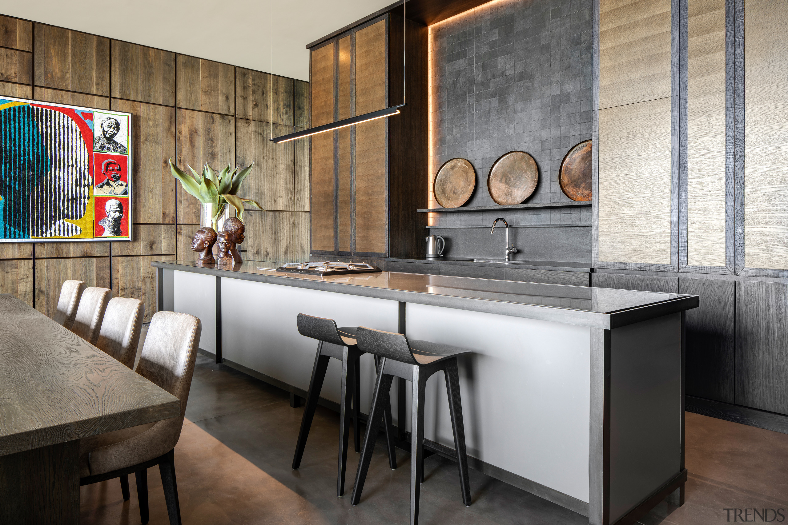 The emphasis on natural materiality can be seen architecture, building, cabinetry, countertop, dining room, floor, flooring, furniture, house, interior design, kitchen, material property, property, real estate, room, table, wall, gray, black