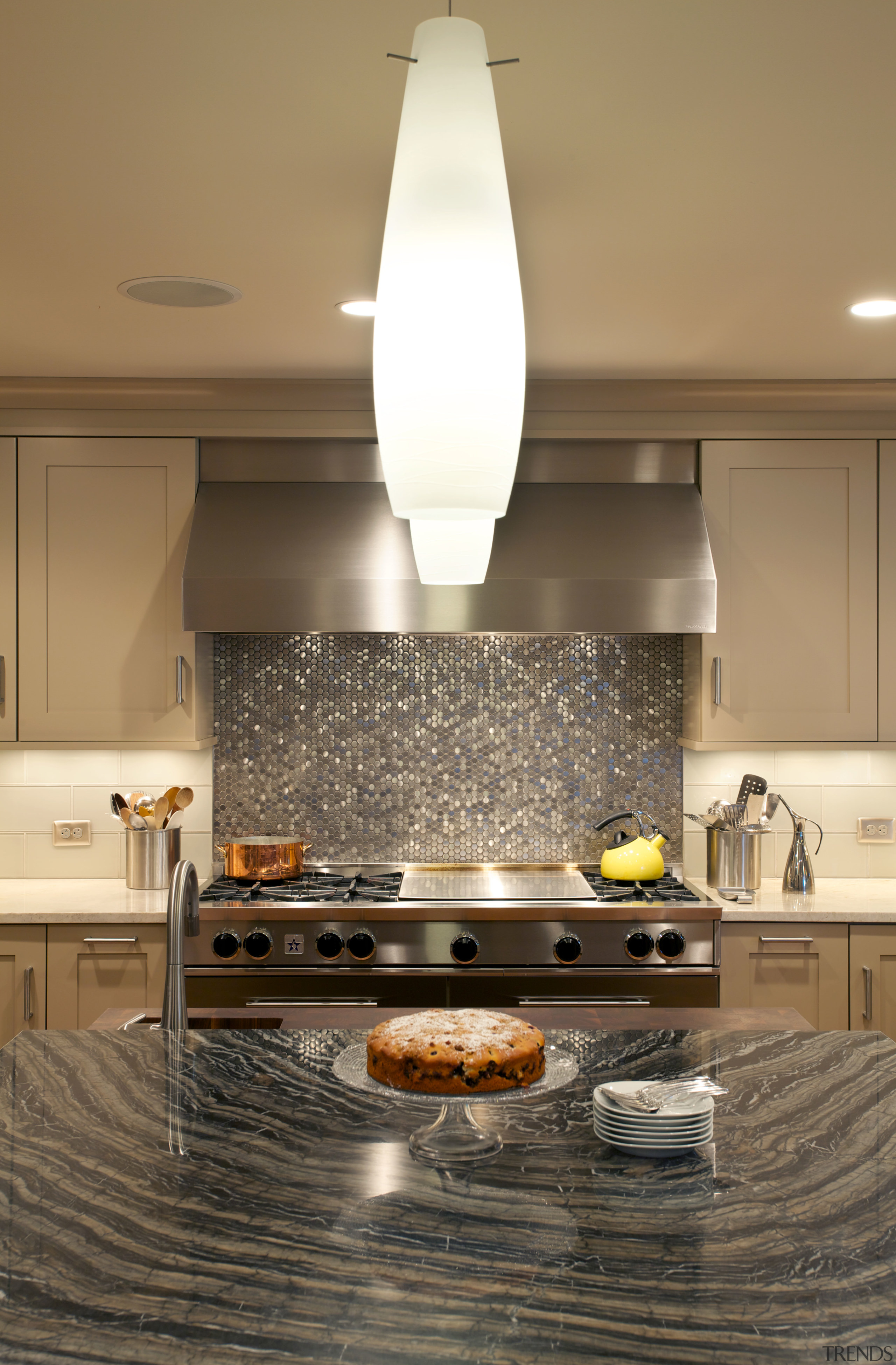 The new kitchen features an exotic granite island countertop, flooring, interior design, kitchen, light fixture, room, under cabinet lighting, brown