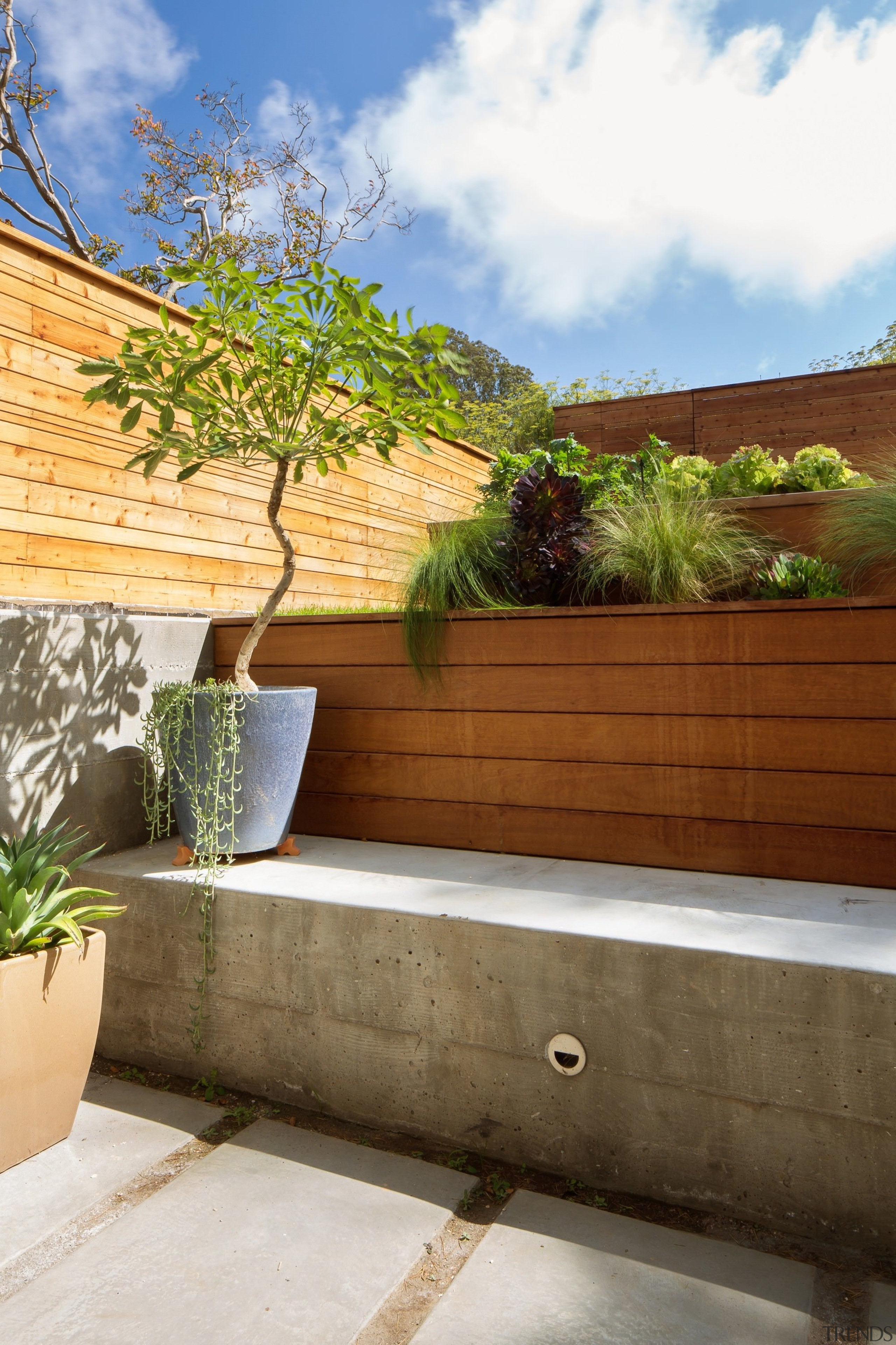 The terraced garden is a unique solution to architecture, backyard, estate, home, house, landscape, outdoor structure, plant, property, real estate, tree, wall, brown