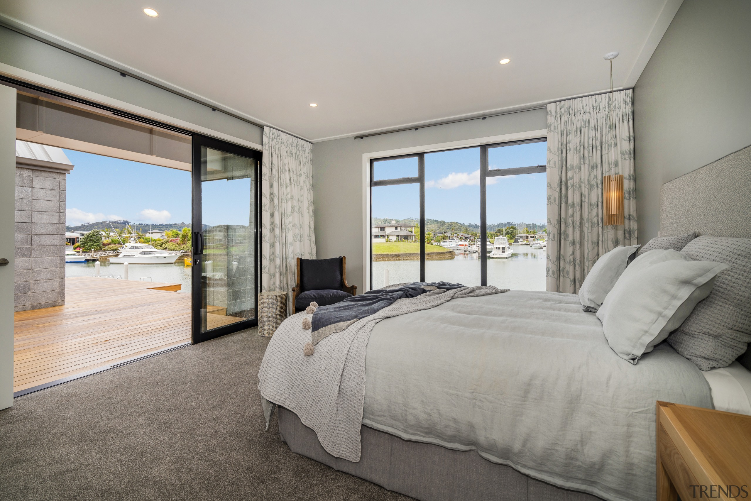 ​​​​​​​The master bedroom, with, giant sliders retracted, is architecture, bedroom, bed, floor, house, interior design, property, master bedroom, Landmark Homes,  Coromandel