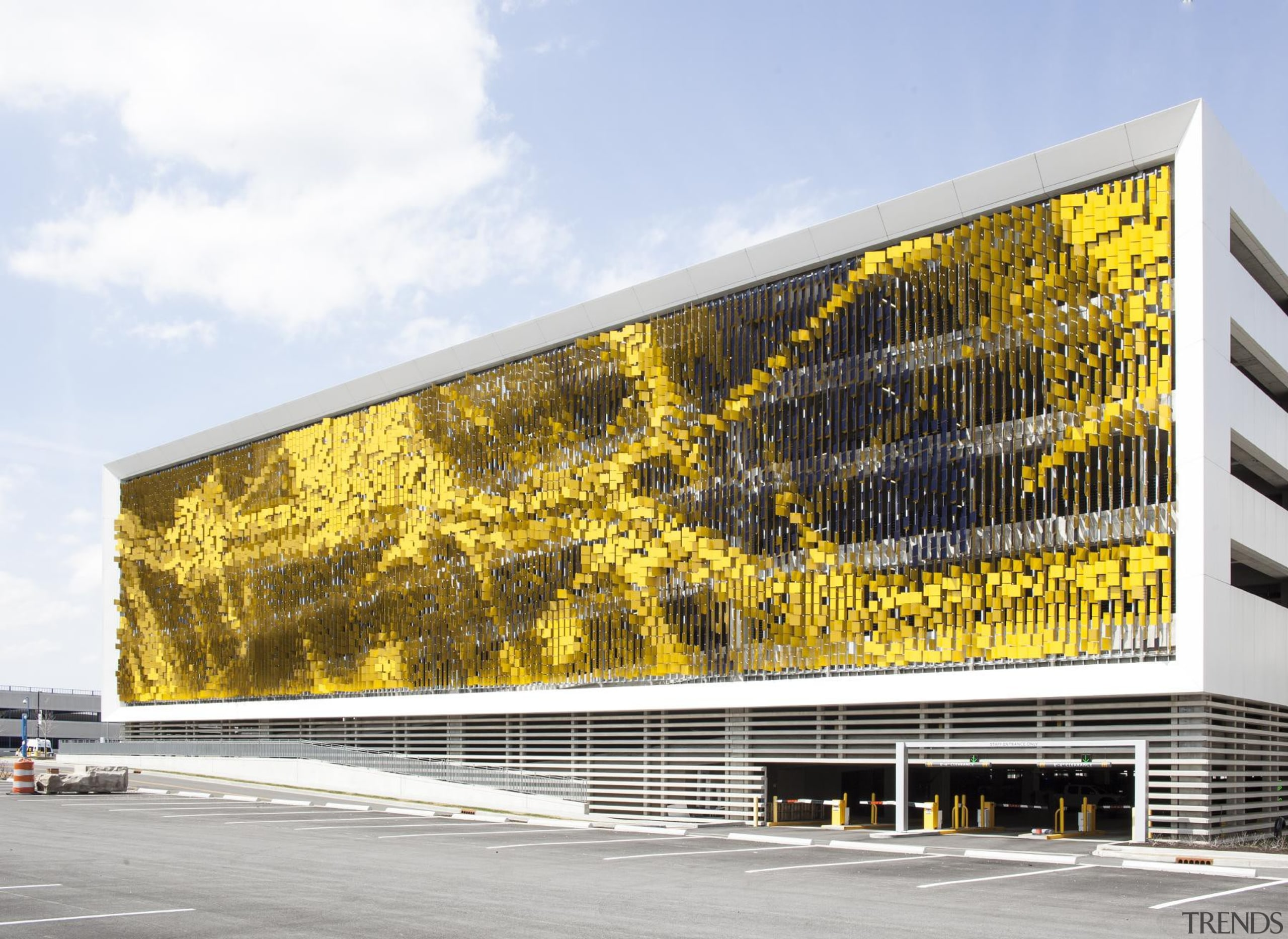This display on the parking structure at Eskenazi architecture, building, corporate headquarters, facade, headquarters, mixed use, yellow, white