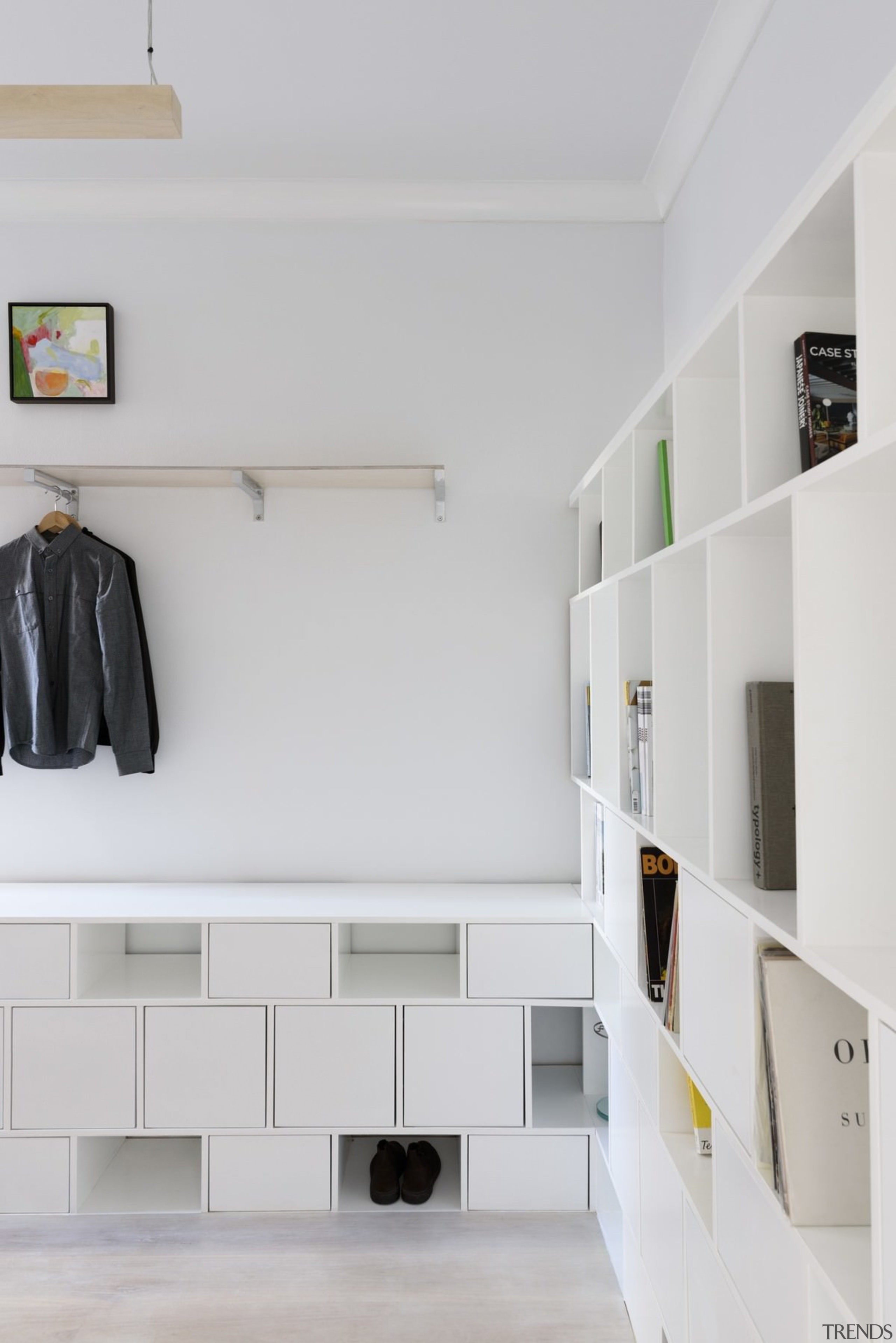There's room for shoes, coats, books and more architecture, floor, furniture, interior design, product design, room, shelf, shelving, wall, gray
