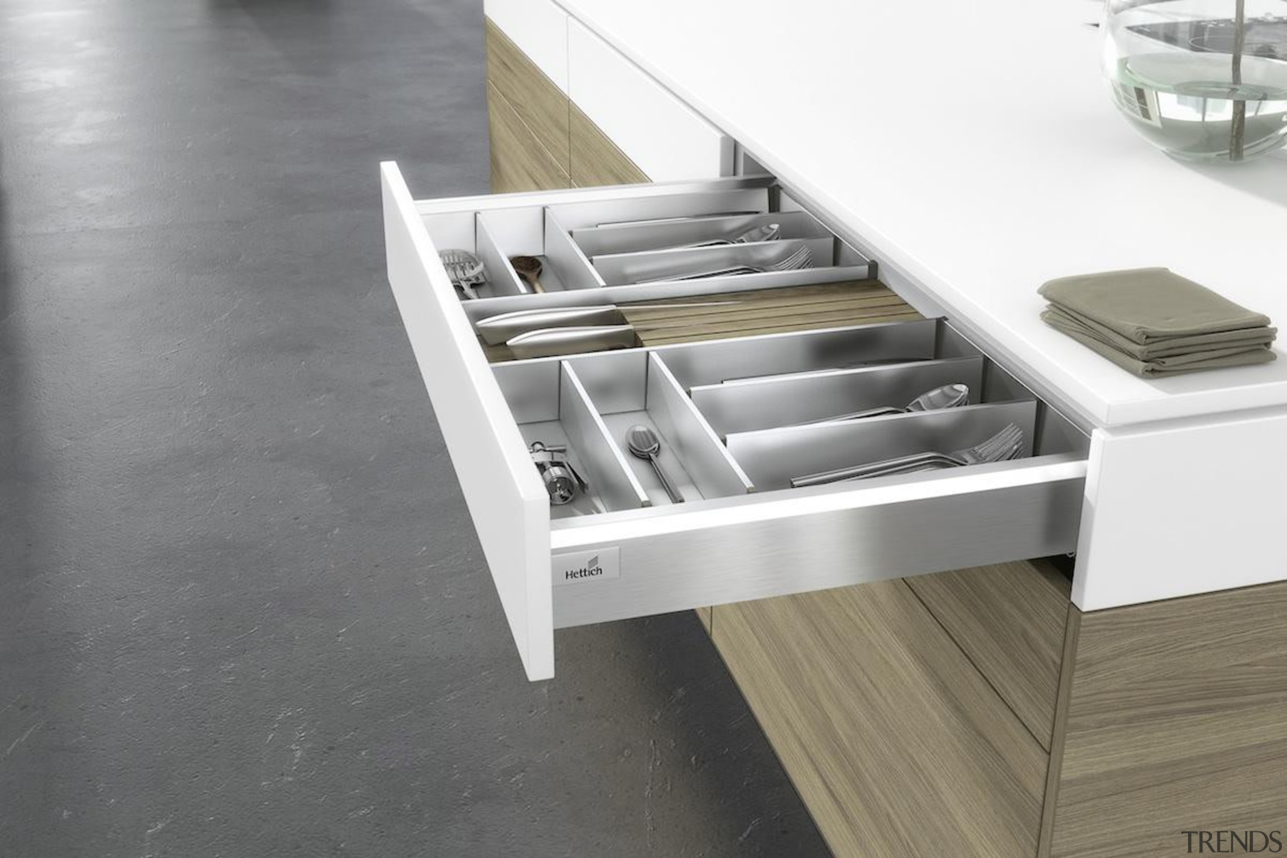 A gentle press on the front panel of floor, furniture, product, table, gray, white