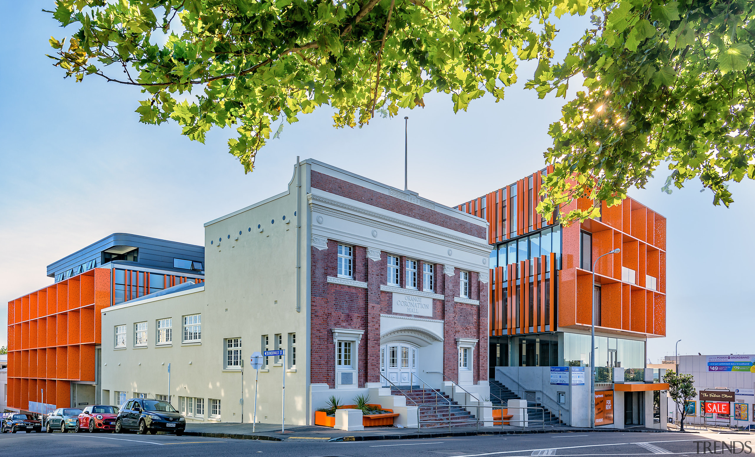 The Orange is a mixed-use Auckland development combining apartment, architecture, building, city, commercial building, elevation, facade, home, house, metropolitan area, mixed use, neighbourhood, real estate, residential area, white