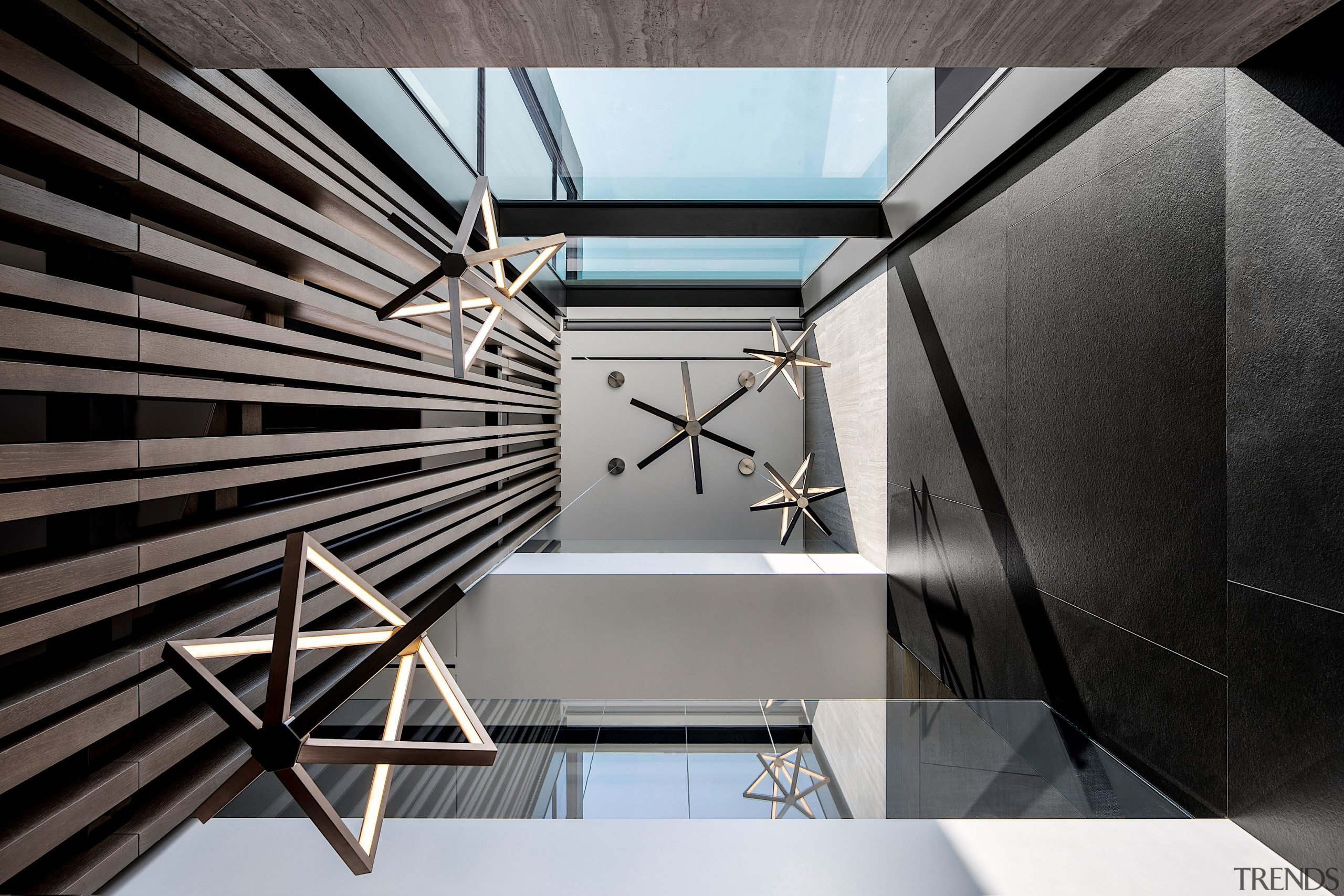 The entryway features a triple-volume atrium and graphic