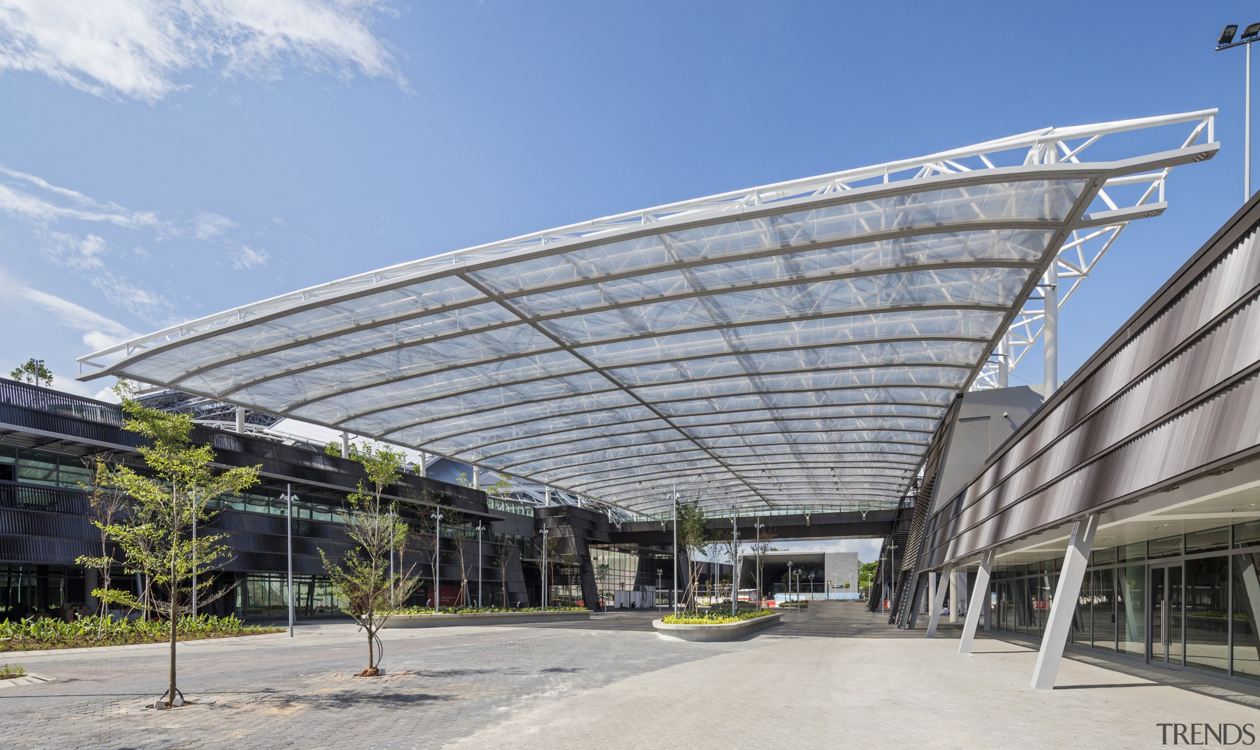 A semi-transparent roof element, which echoes the form architecture, building, convention center, corporate headquarters, daylighting, facade, headquarters, metropolitan area, mixed use, roof, structure, gray, teal