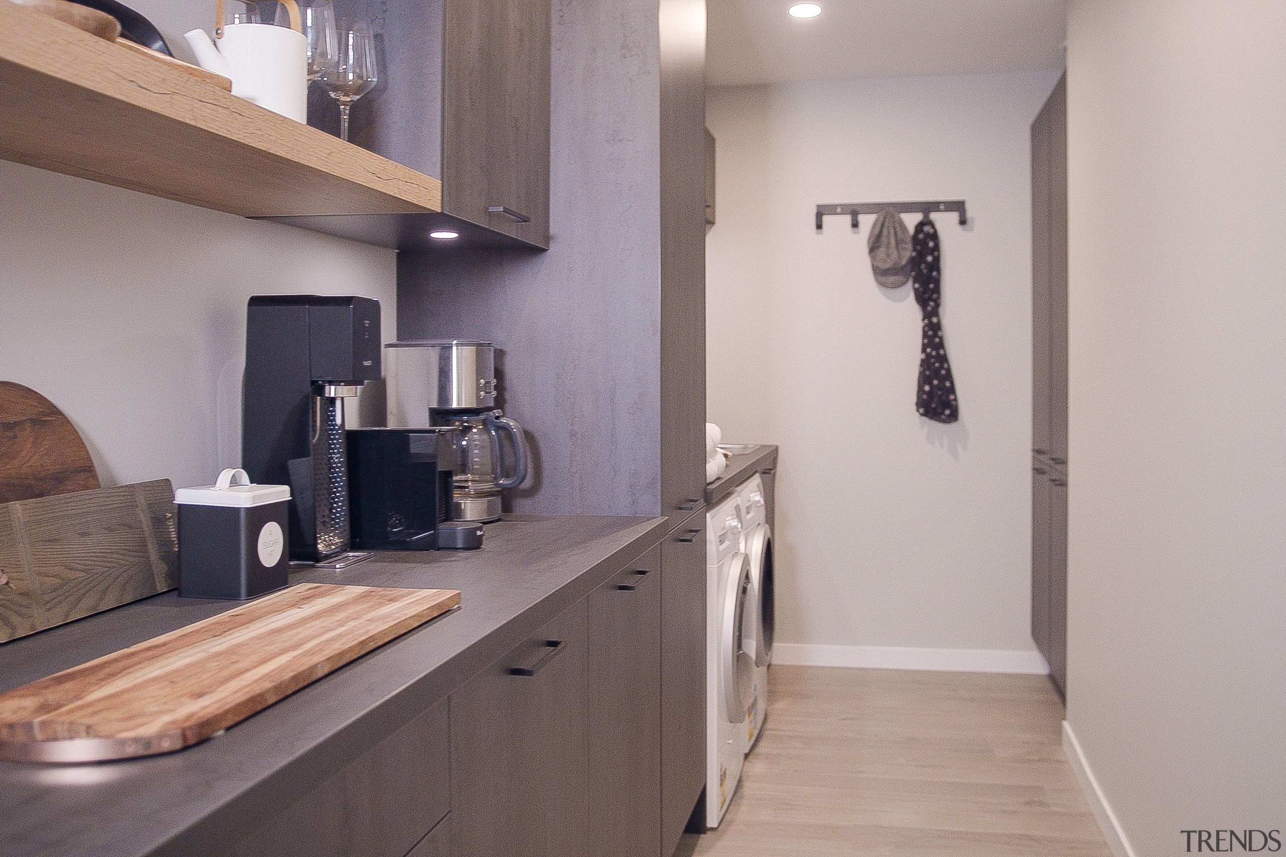 The laundry area runs on from the kitchen.