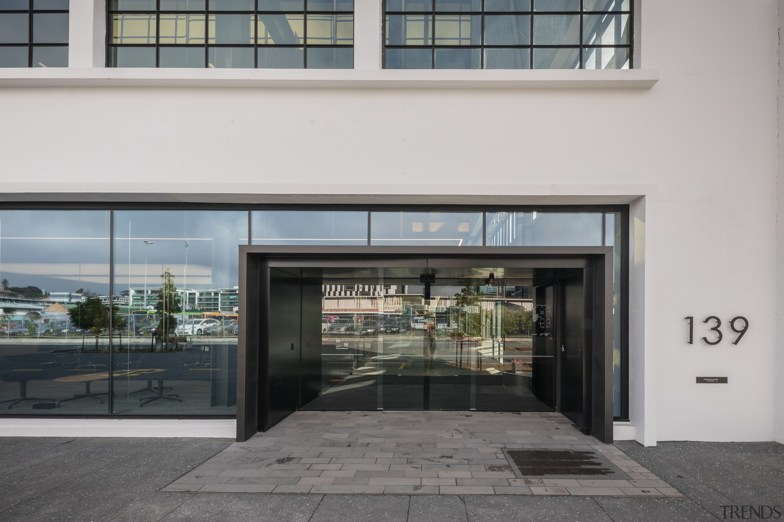 The front entry to architects Warren and Mahoneys building, door, facade, gray