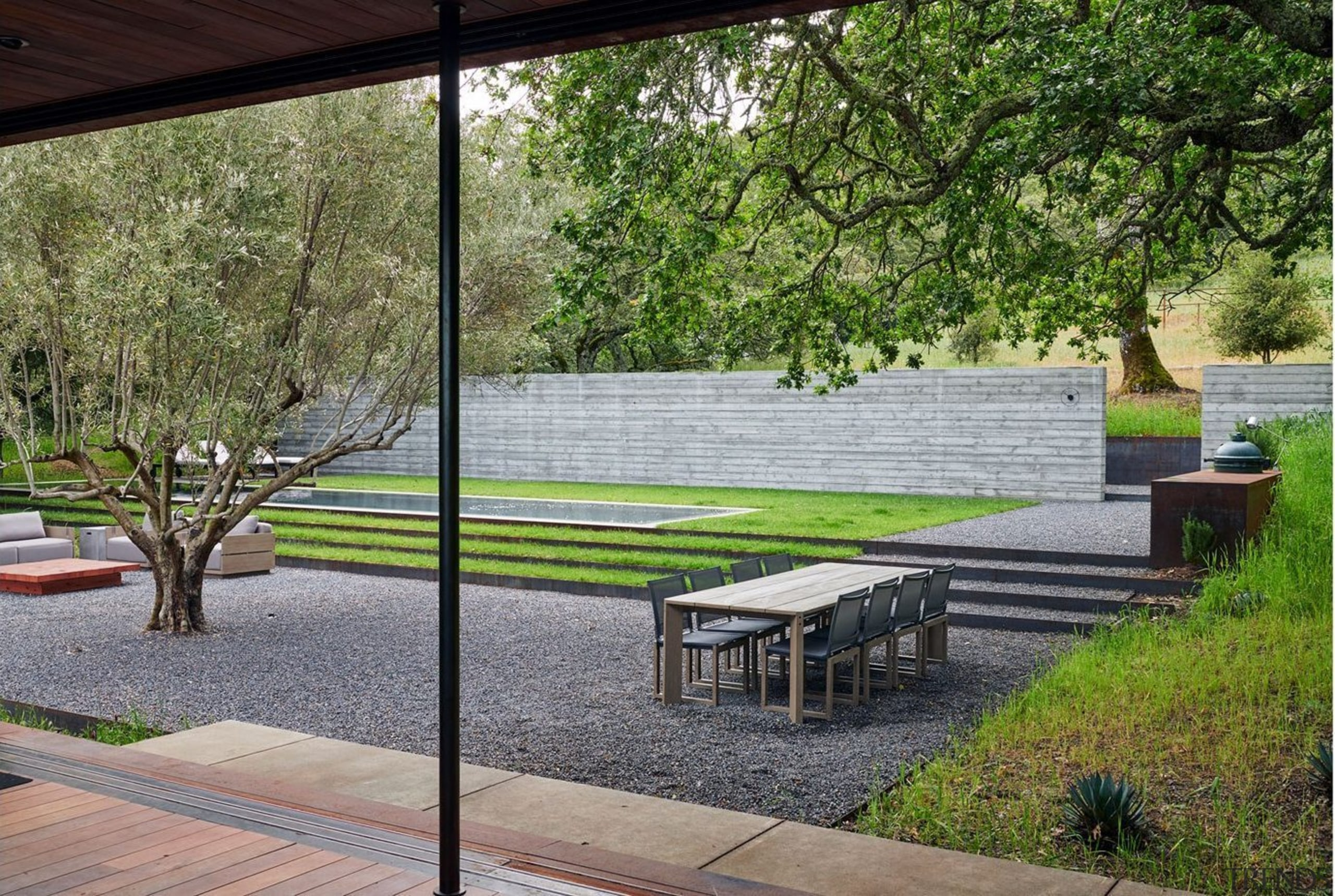 Serene and spacious, this landscaped outdoor space won gray, brown