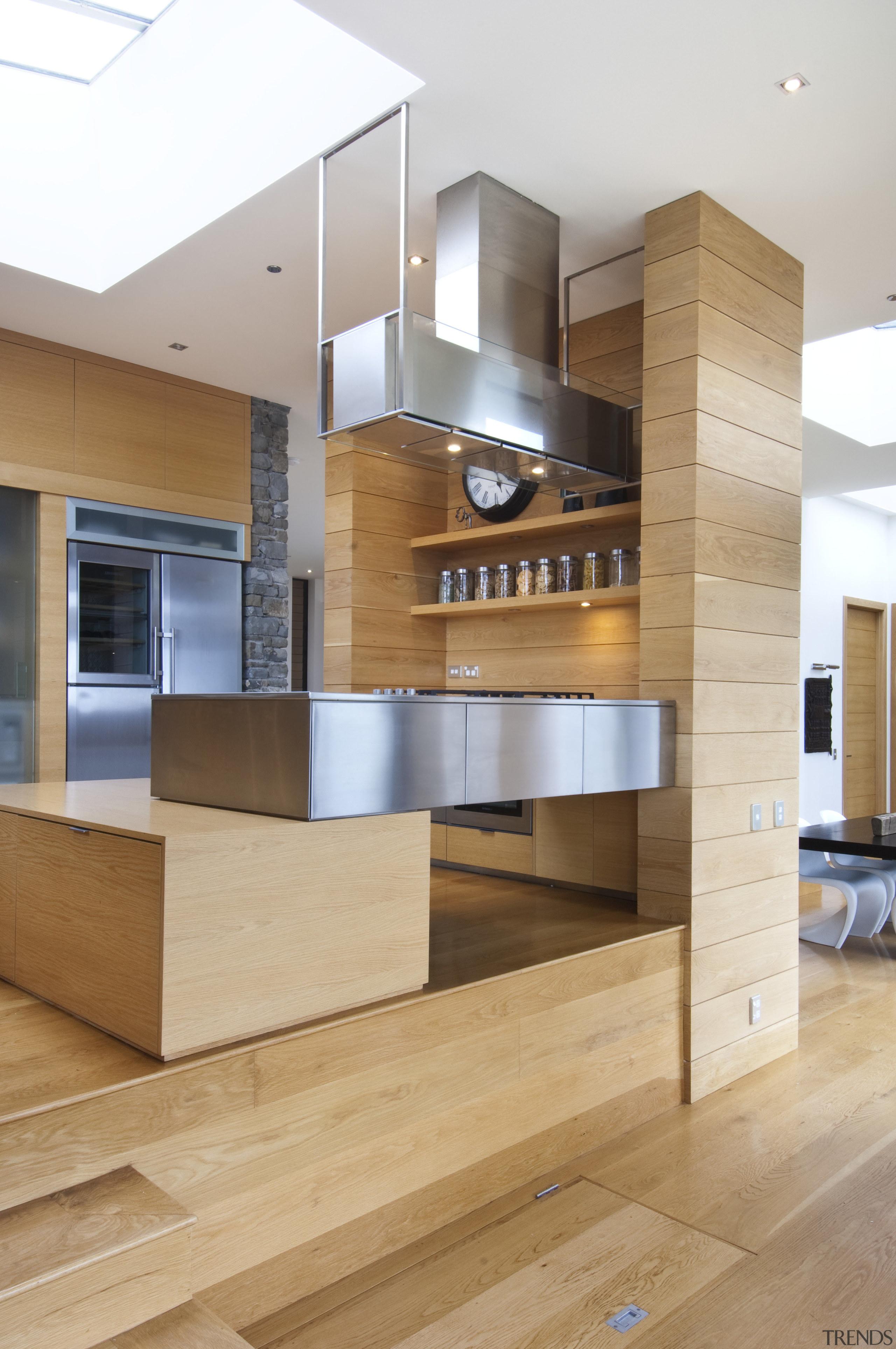 Raised floor kitchen. Stainless steel Binova cooktop. American cabinetry, floor, flooring, furniture, hardwood, interior design, kitchen, wood, wood flooring, orange