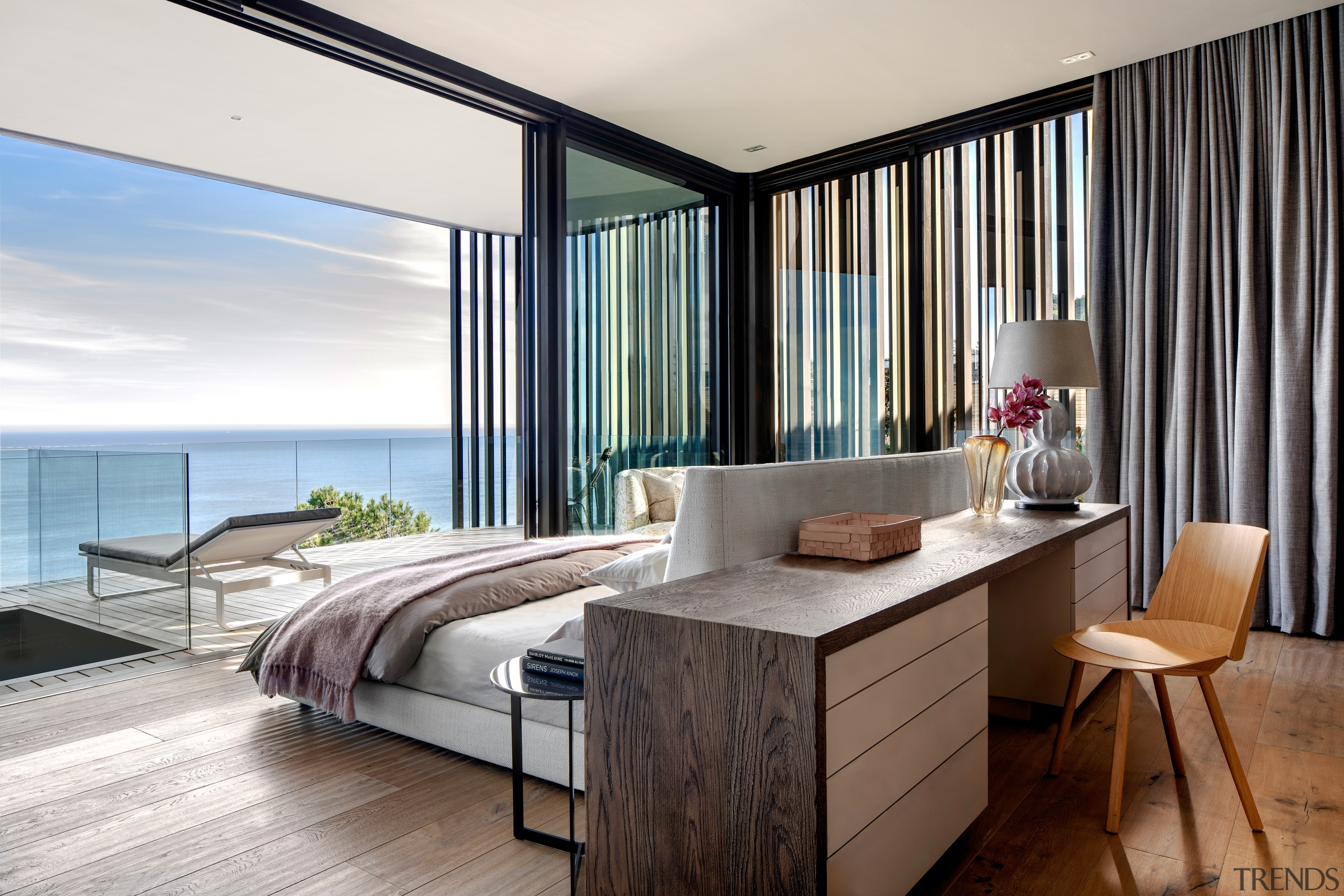 Everything in this bedroom is orientated towards the apartment, architecture, bedroom, building, ceiling, curtain, floor, furniture, home, house, interior design, living room, penthouse apartment, property, real estate, room, suite, table, wall, white