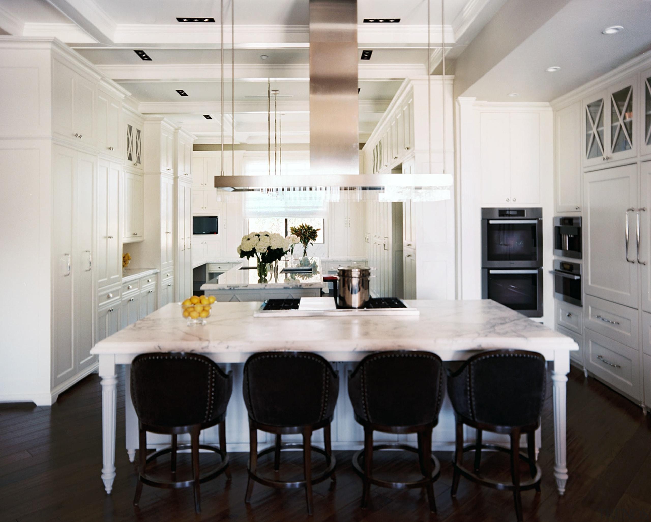 Black bar stools and a dark walnut floor cabinetry, countertop, cuisine classique, dining room, floor, flooring, interior design, kitchen, room, wood flooring, white, black