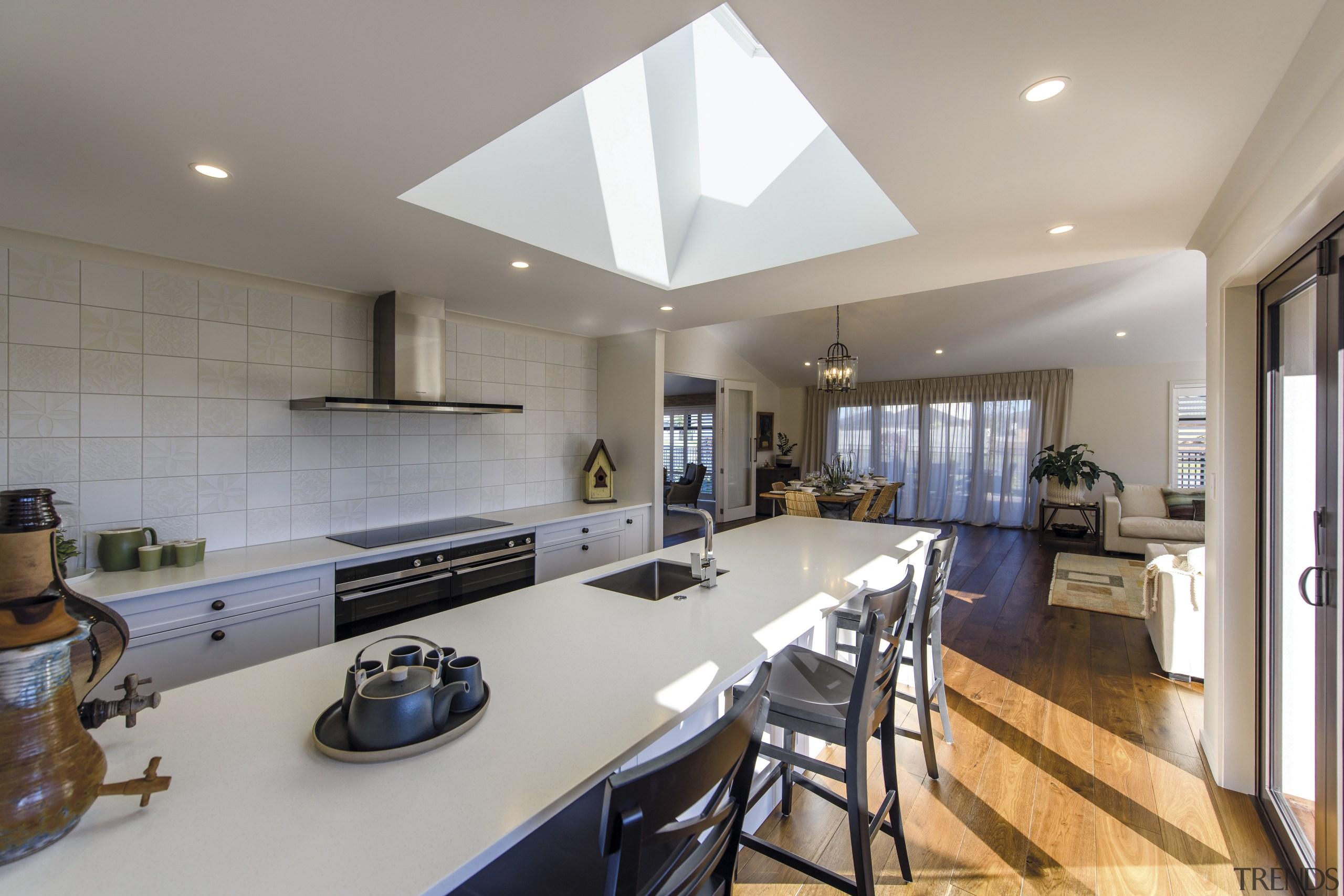 The kitchen in this Tauranga GJ Gardner showhome countertop, interior design, kitchen, real estate, room, gray